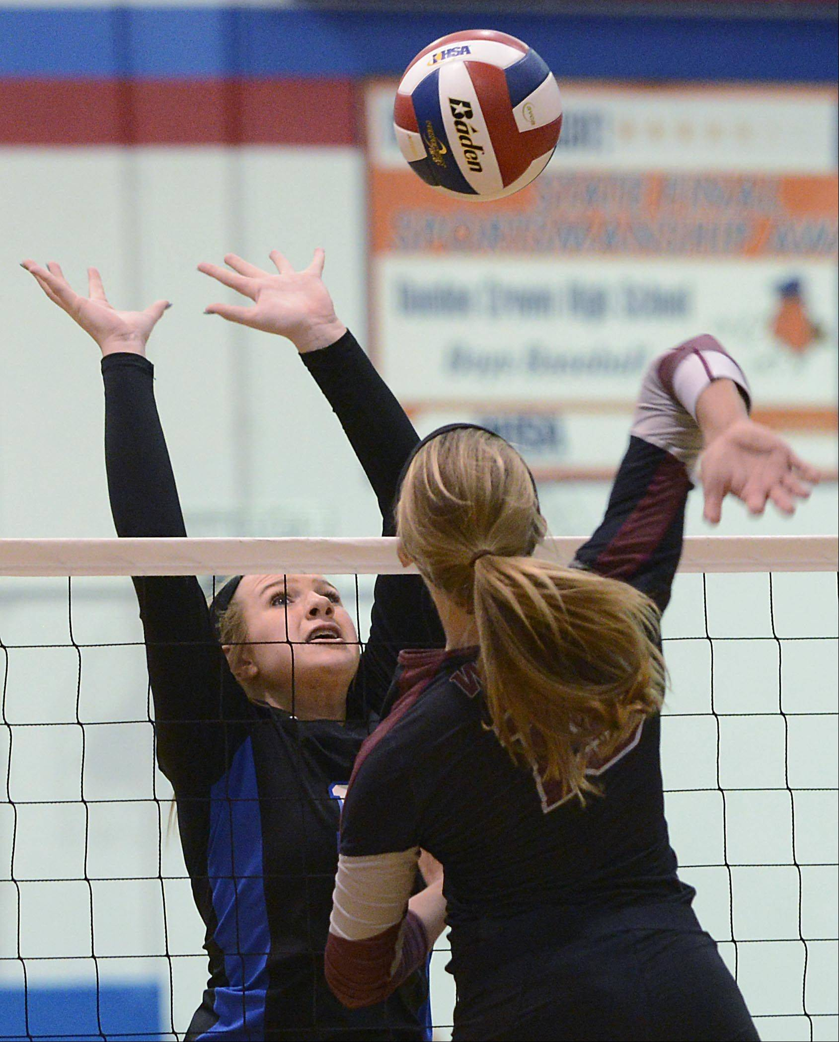 Prairie Ridge's Ali Witt lines up a shot against Dundee-Crown's Kailey Moll Monday in Carpentersville.