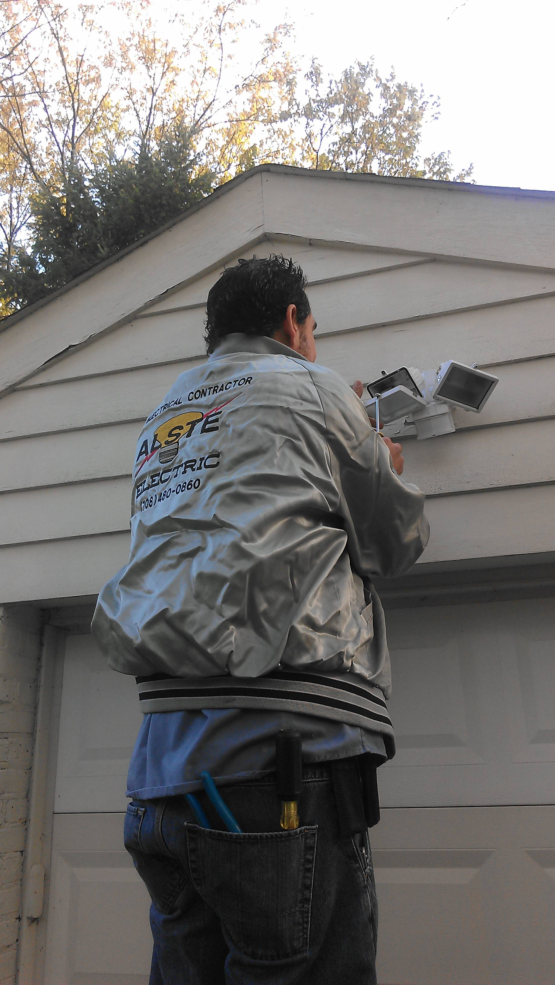 Alan Edelman from ALSTE Electric installing security lighting.