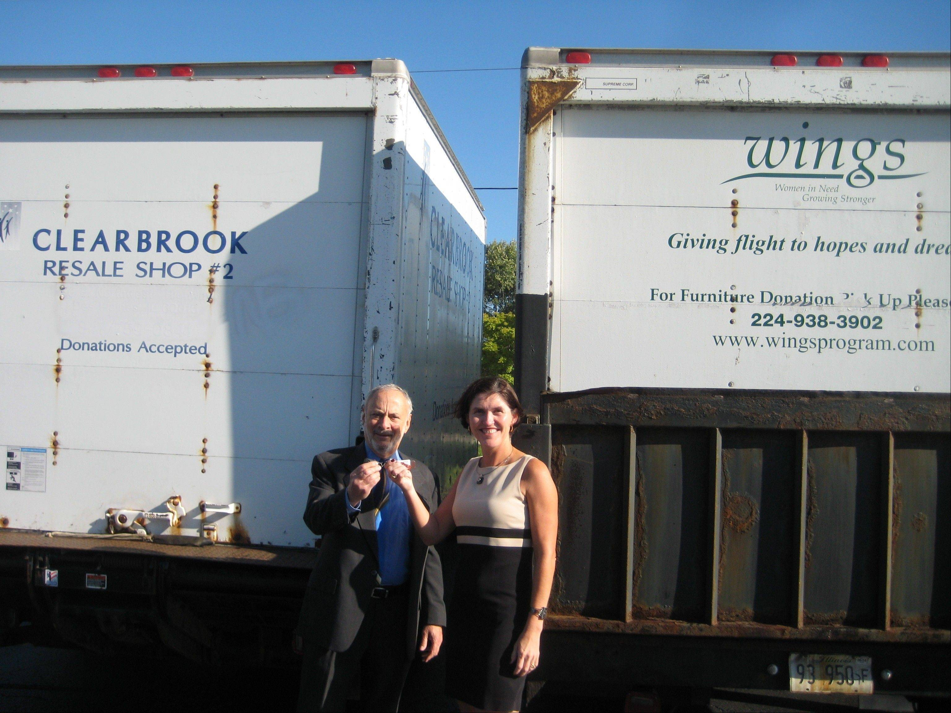Clearbrook President Carl LaMell hands over the truck keys to Rebecca Darr, executive director of WINGS.