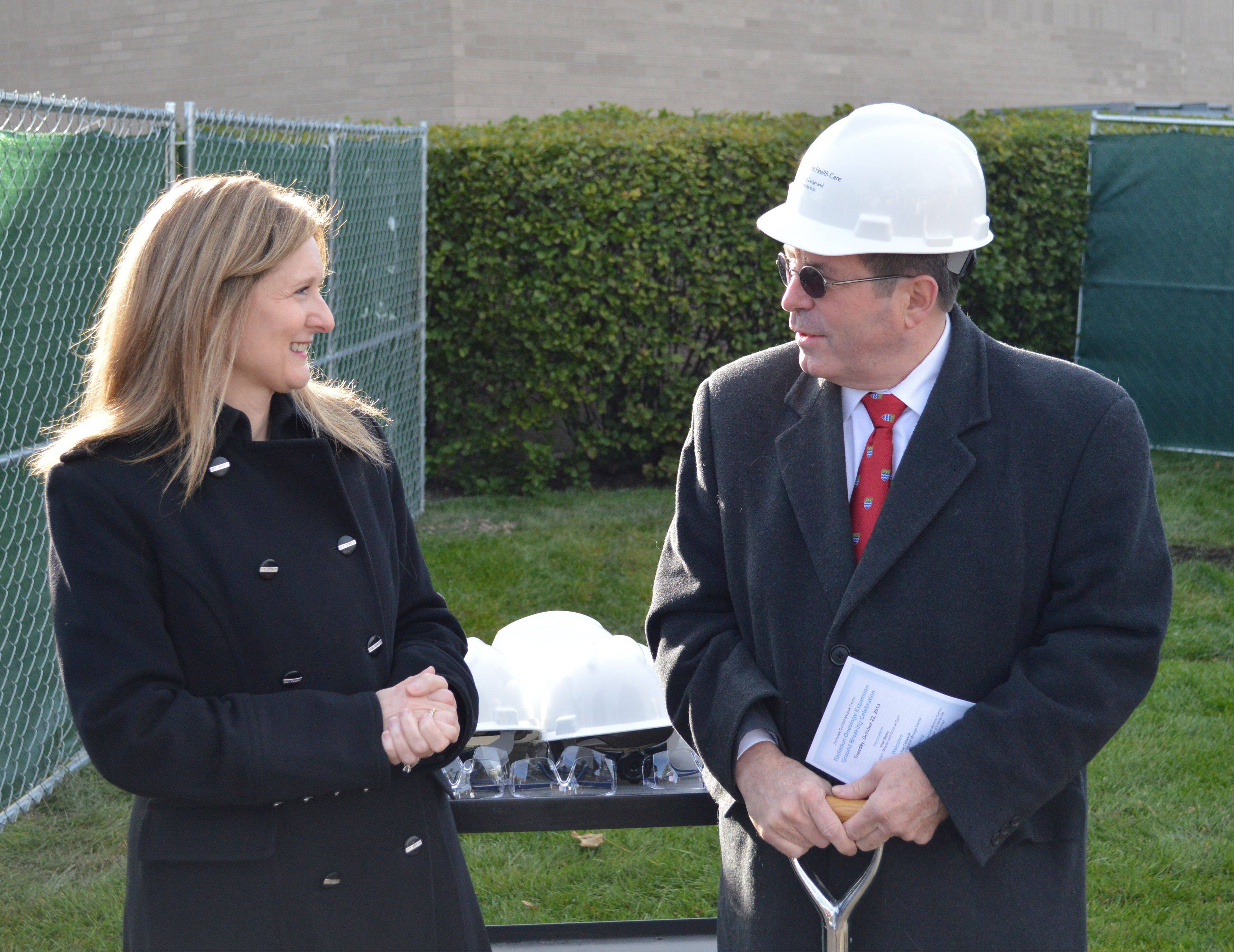 Officials break ground at Advocate Condell Medical Center in Libertyville for its Radiation Oncology and Cancer Survivorship Resource Center. Advocate Condell Medical Center President Dominica Tallarico, left, speaks with Libertyville Mayor Terry Weppler at the event.
