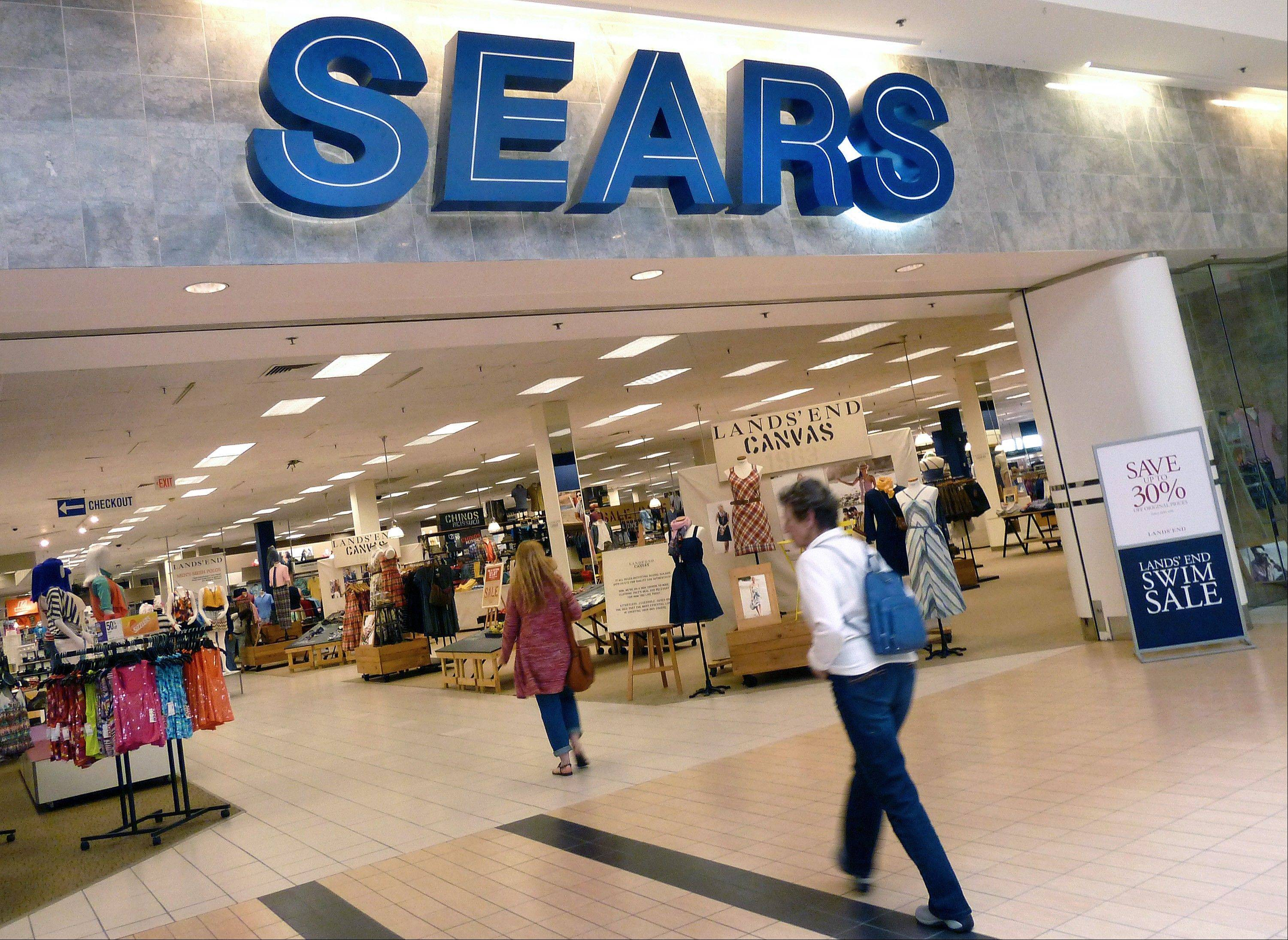 Sears is considering separating its Lands� End and Sears Auto Center businesses from the rest of the company. The retailer also plans to continue closing some unprofitable stores as it moves forward on its turnaround efforts, the company announced Tuesday.