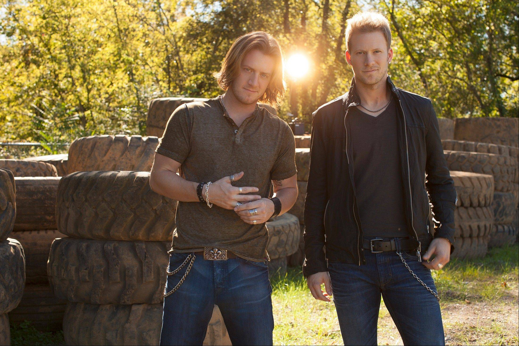 Florida Georgia Line's Tyler Hubbard, left, and Brian Kelley play the Sears Centre Arena in Hoffman Estates Thursday, Oct. 31. The concert sold out in less than five minutes.