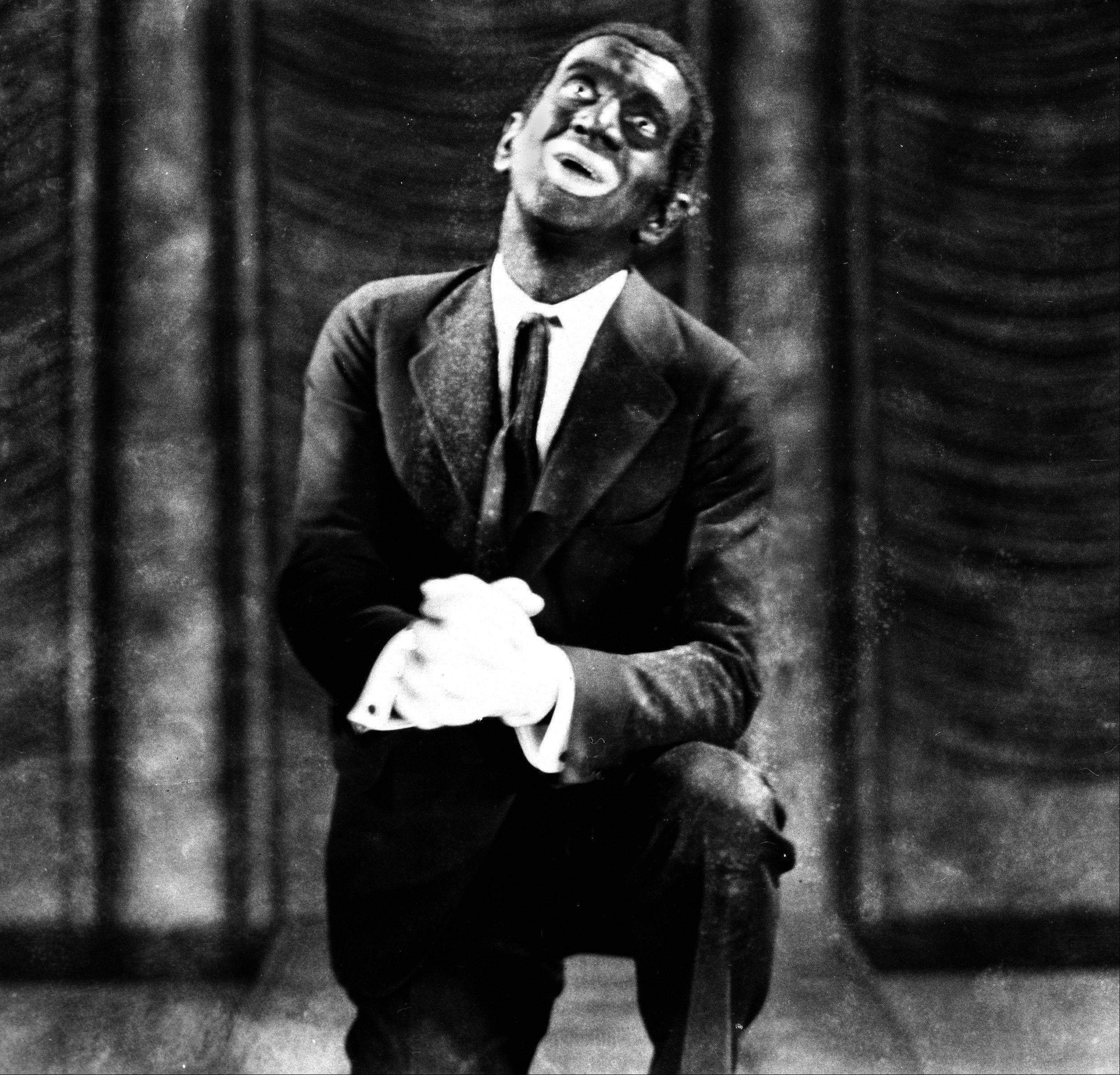 "This 1927 image originally released by Warner Bros., shows Al Jolson in blackface makeup in the movie ""The Jazz Singer."""