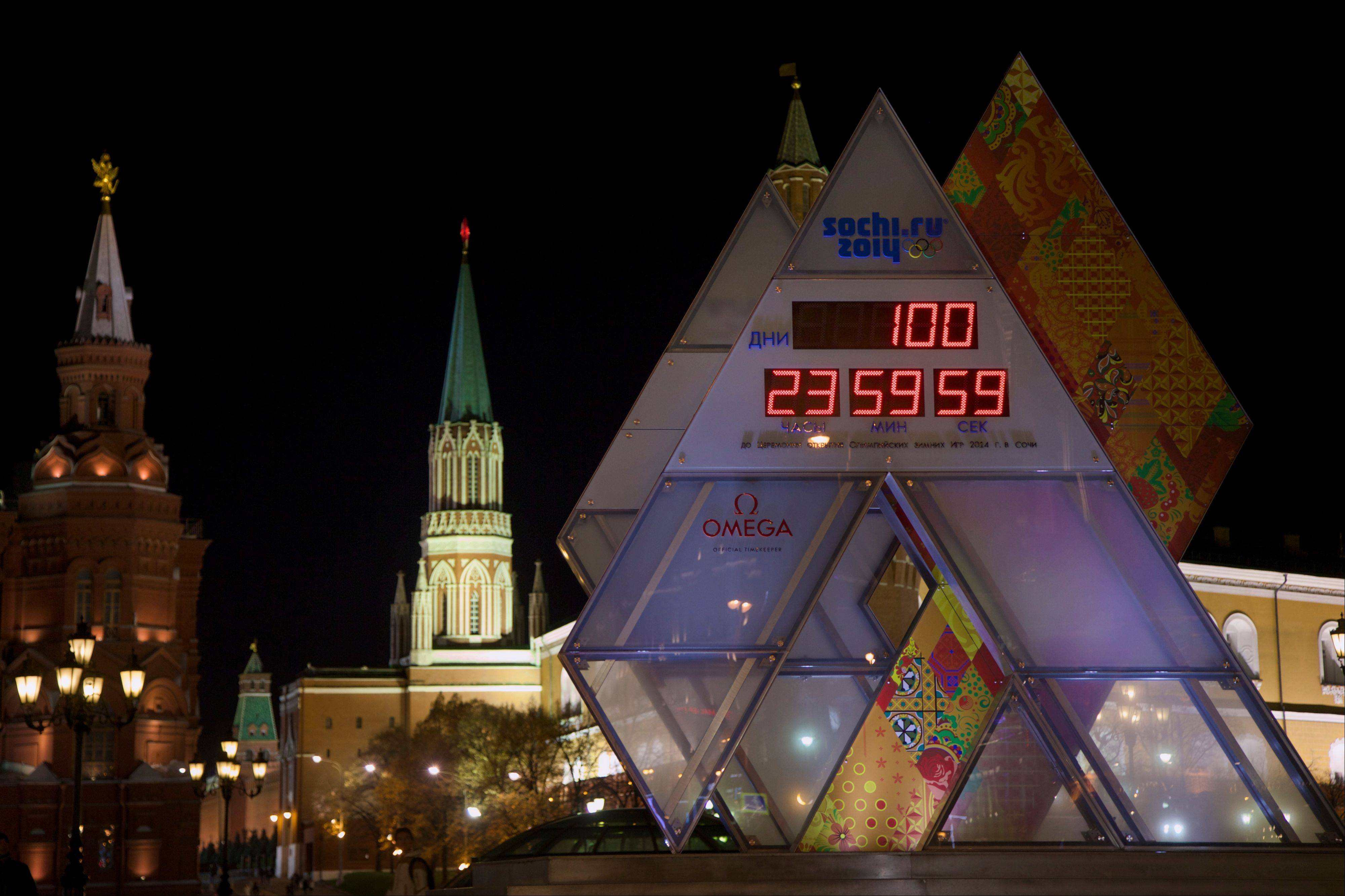 The countdown clock showing 100 days left until the start of 2014 Winter Olympic Games is on display at Manezhnaya square, with the Kremlin wall and towers at the background, in Moscow on Tuesday.