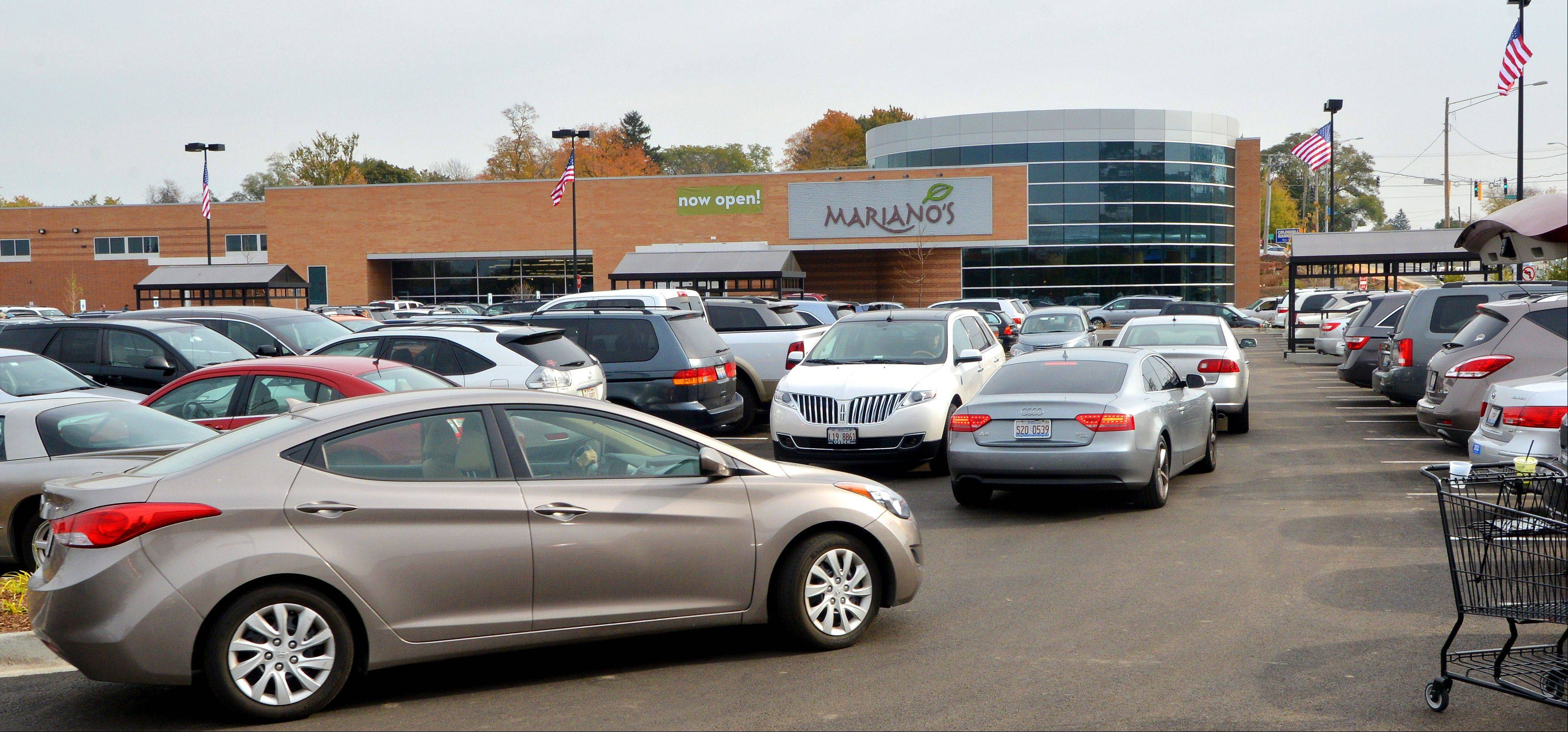 Large crowds packed the Mariano's Fresh Market in Wheaton Tuesday as the store opened for the first time. Both the parking lot adjacent the store and the spillover lot across Main Street were completely filled during the midmorning hours.