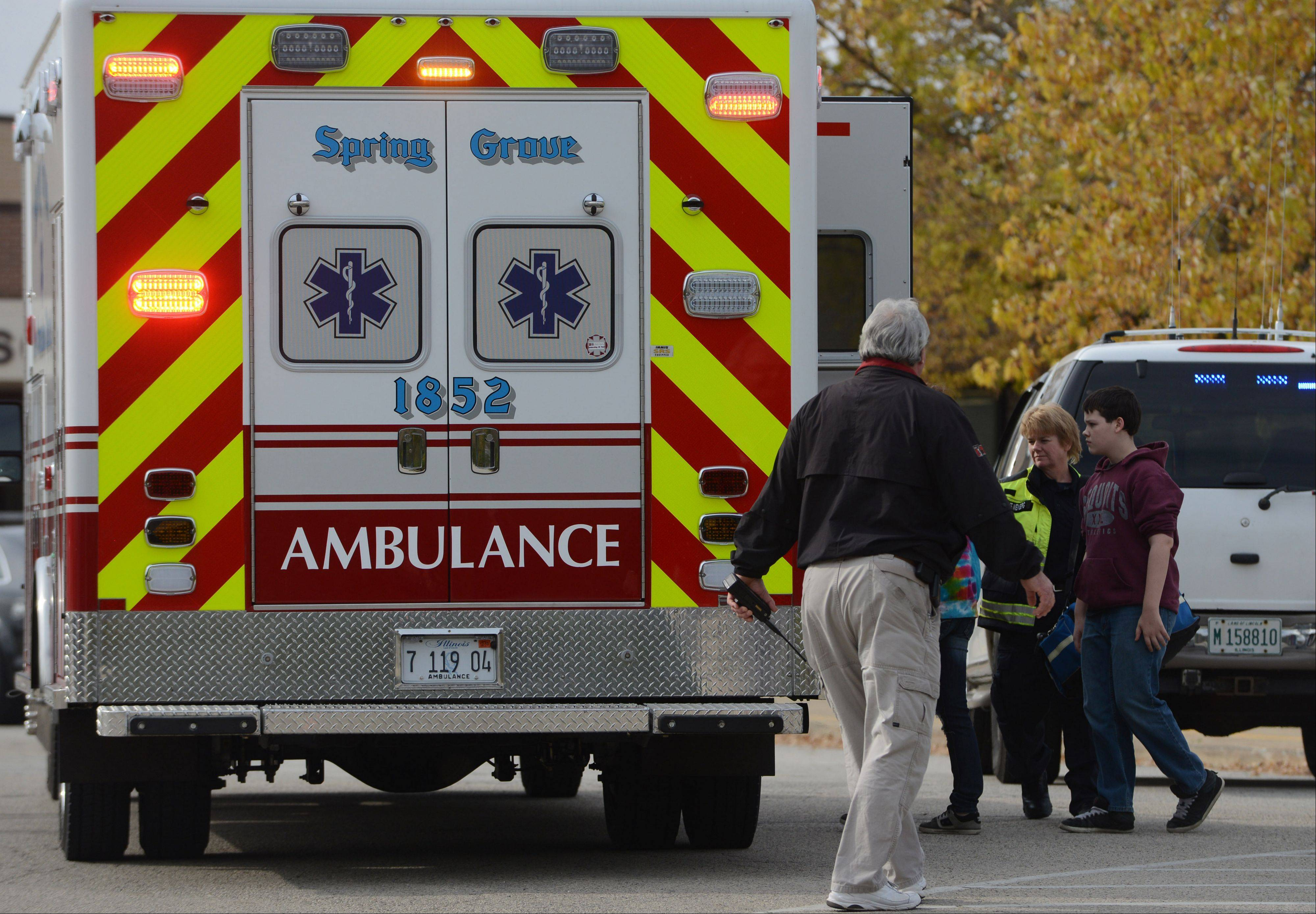 Students are taken to an ambulance Tuesday at Antioch Upper Grade School. Ten students were transported after taking a prescription painkiller.