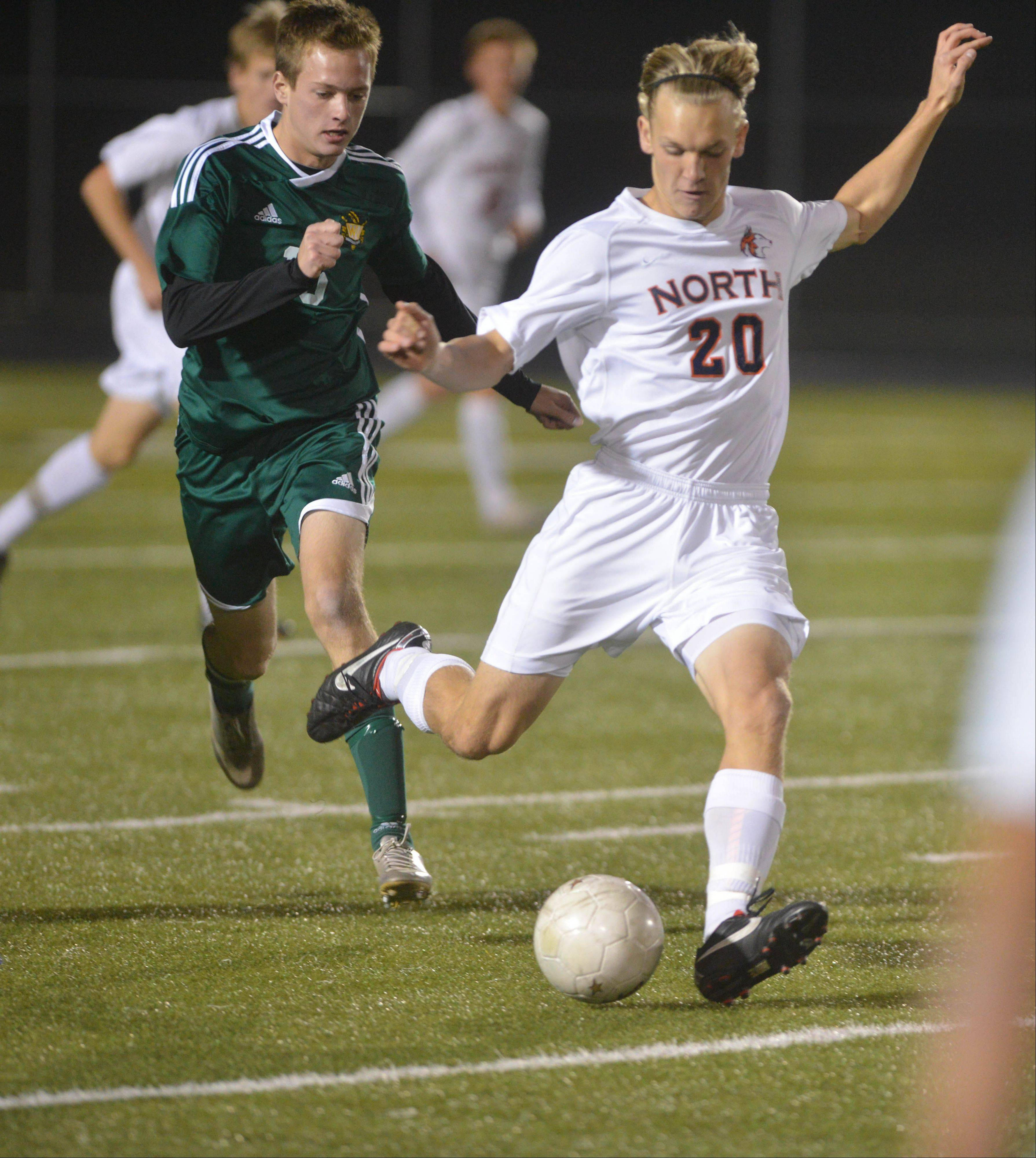 Grant Borg of Naperville North moves the ball down feild during the Naperville North vs. Waubonsie Valley boys soccer Class 3A Metea Valley sectional semifinals game Tuesday.