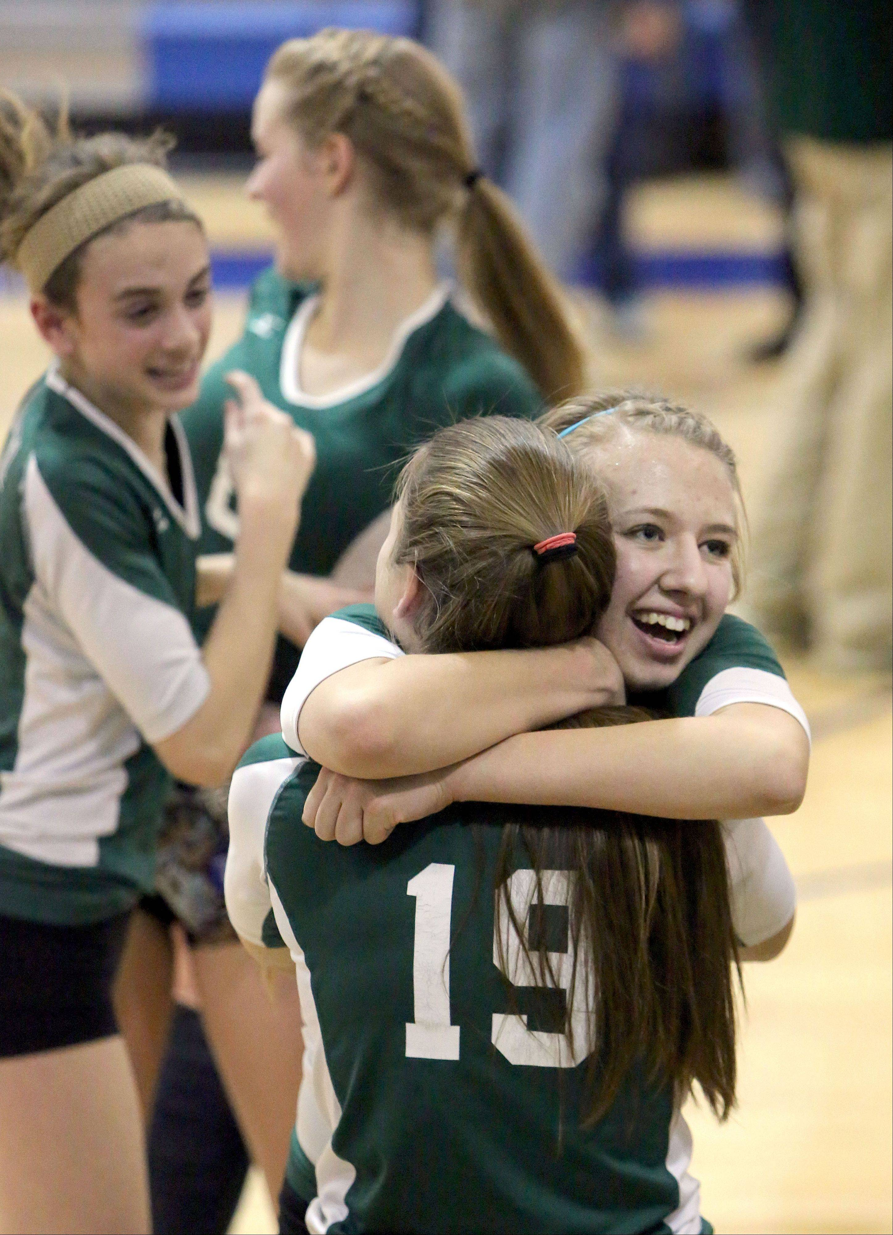 Steve Lundy/slundy@dailyherald.com Grayslake Central's Nikki Orfanos (19) and Taylor O'Neil celebrate after beating Antioch during the girls regional semifinal volleyball game Tuesday at Lakes High School.
