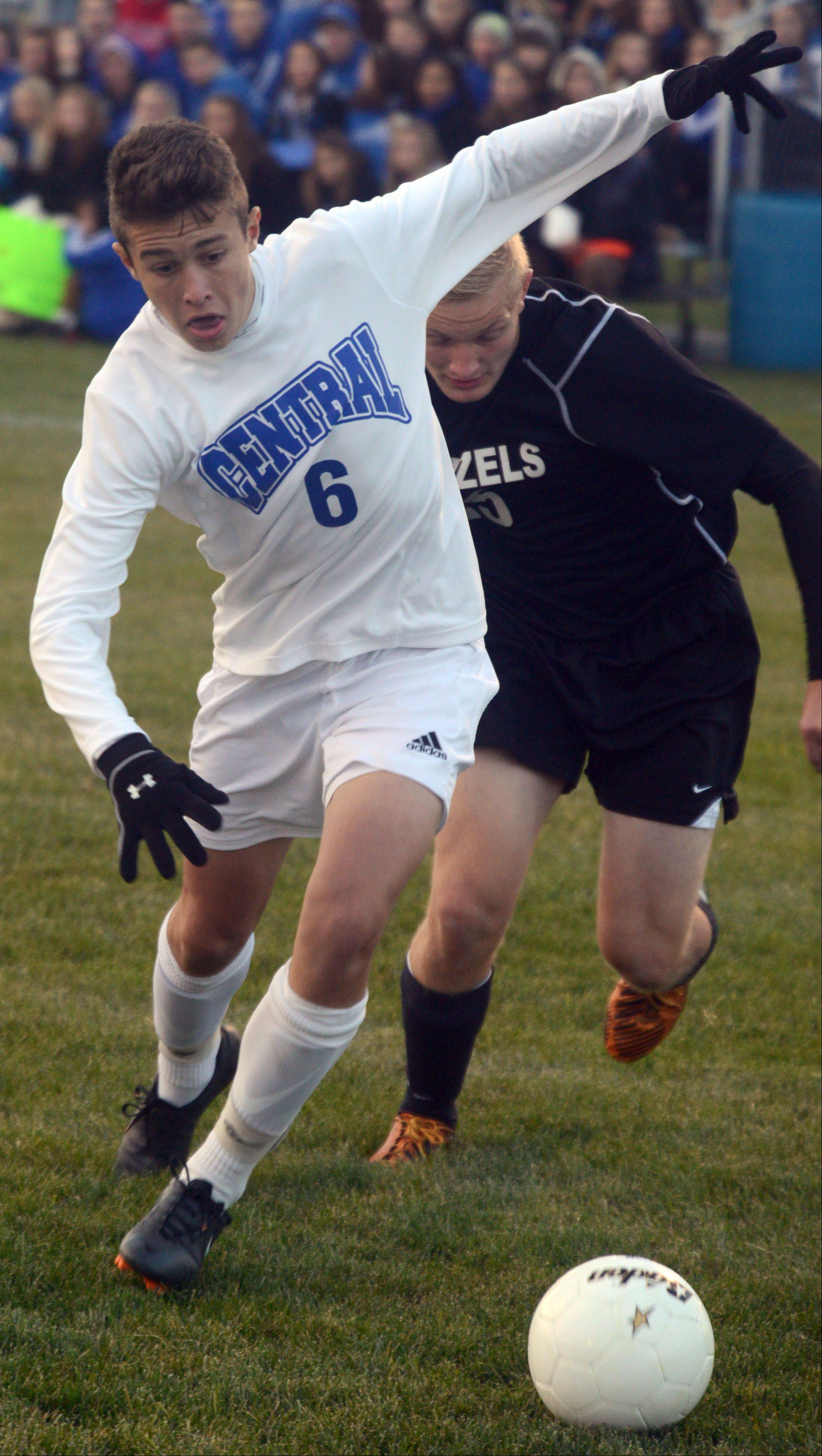 Burlington Central's Nate McMahon, left, races Freeport's Andrew Woods to the ball during a soccer sectional semifinal game at Burlington on Tuesday night.
