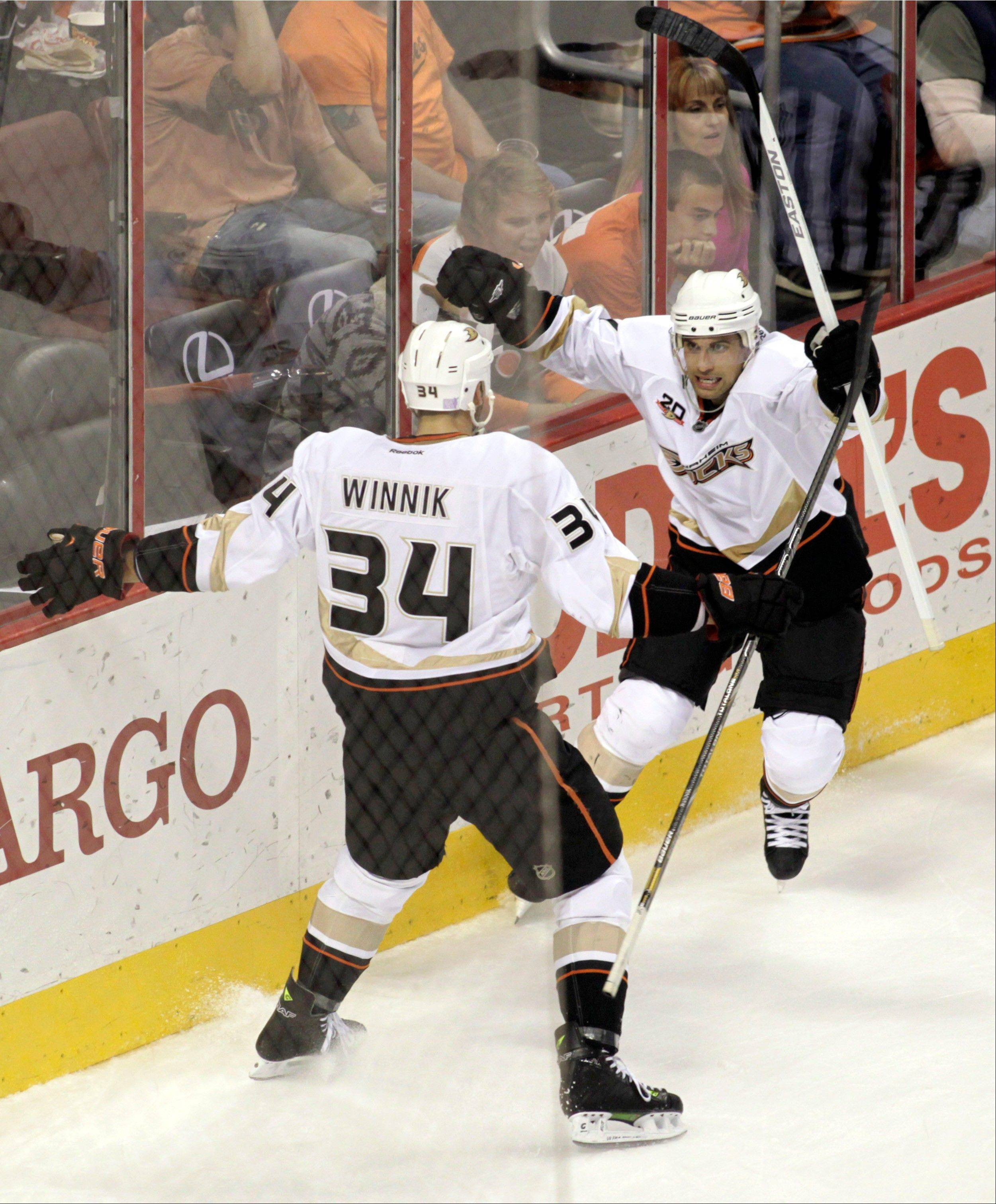 Anaheim Ducks' Andrew Cogliano, right celebrates with Daniel Winnik (34) after scoring against the Philadelphia Flyers in the second period of an NHL hockey game Tuesday in Philadelphia.