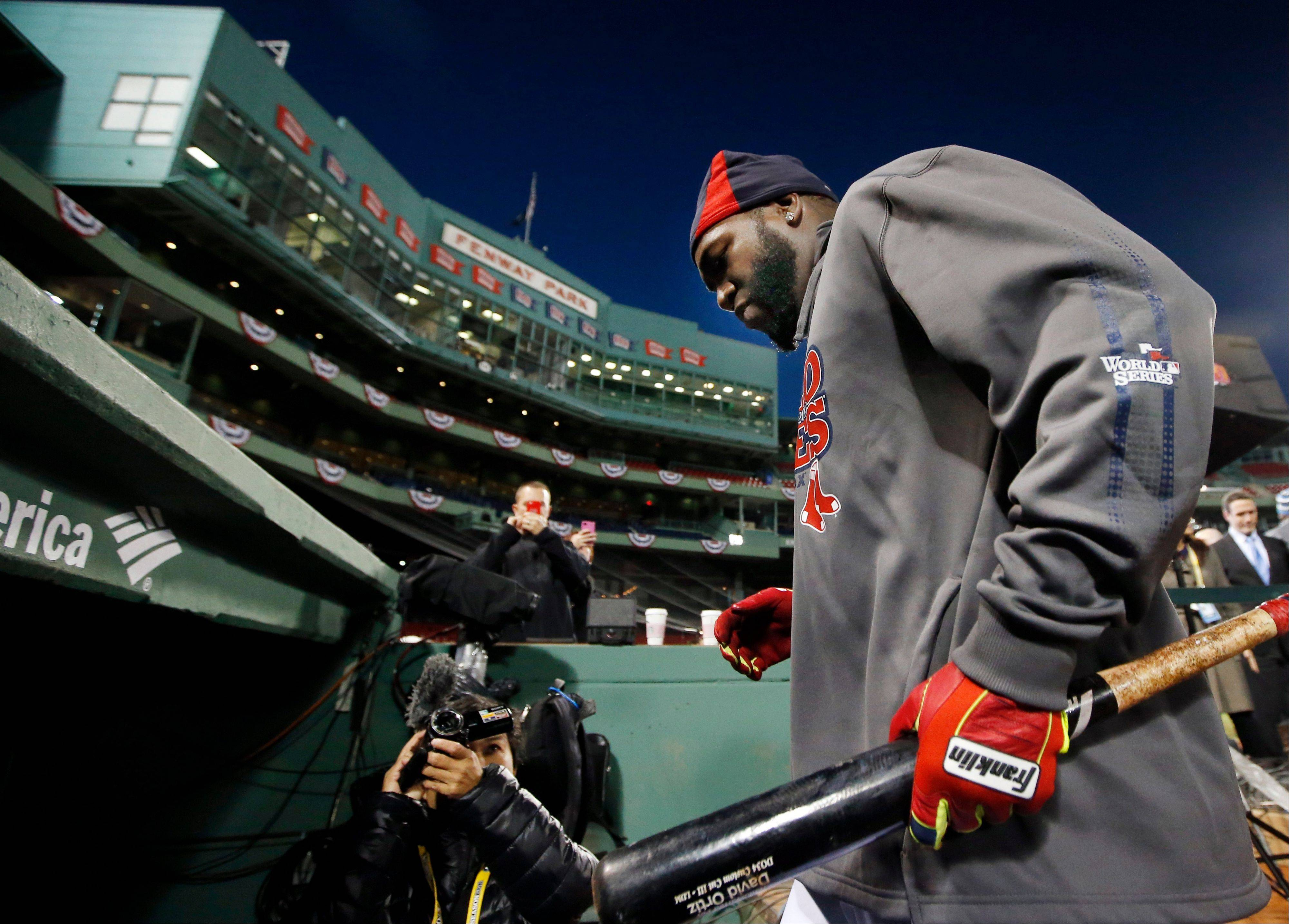 Boston Red Sox designated hitter David Ortiz walks into the dugout after a workout Tuesday at Fenway Park in Boston. The Red Sox are scheduled to host the St. Louis Cardinals in Game 6 of baseball's World Series on Wednesday.