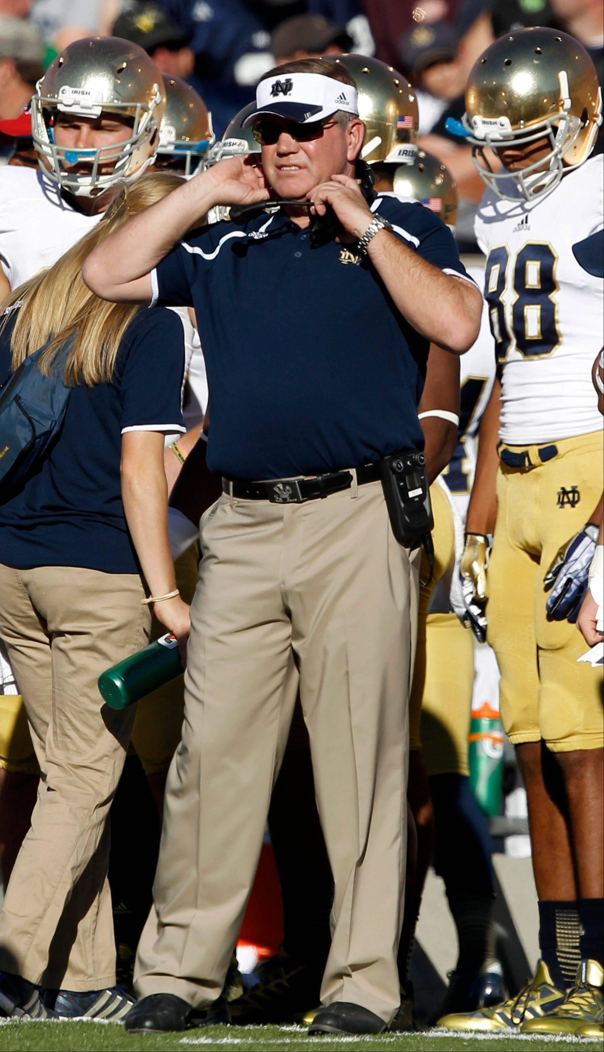 Notre Dame head coach Brian Kelly watches the second quarter of Saturday's road game against Air Force.