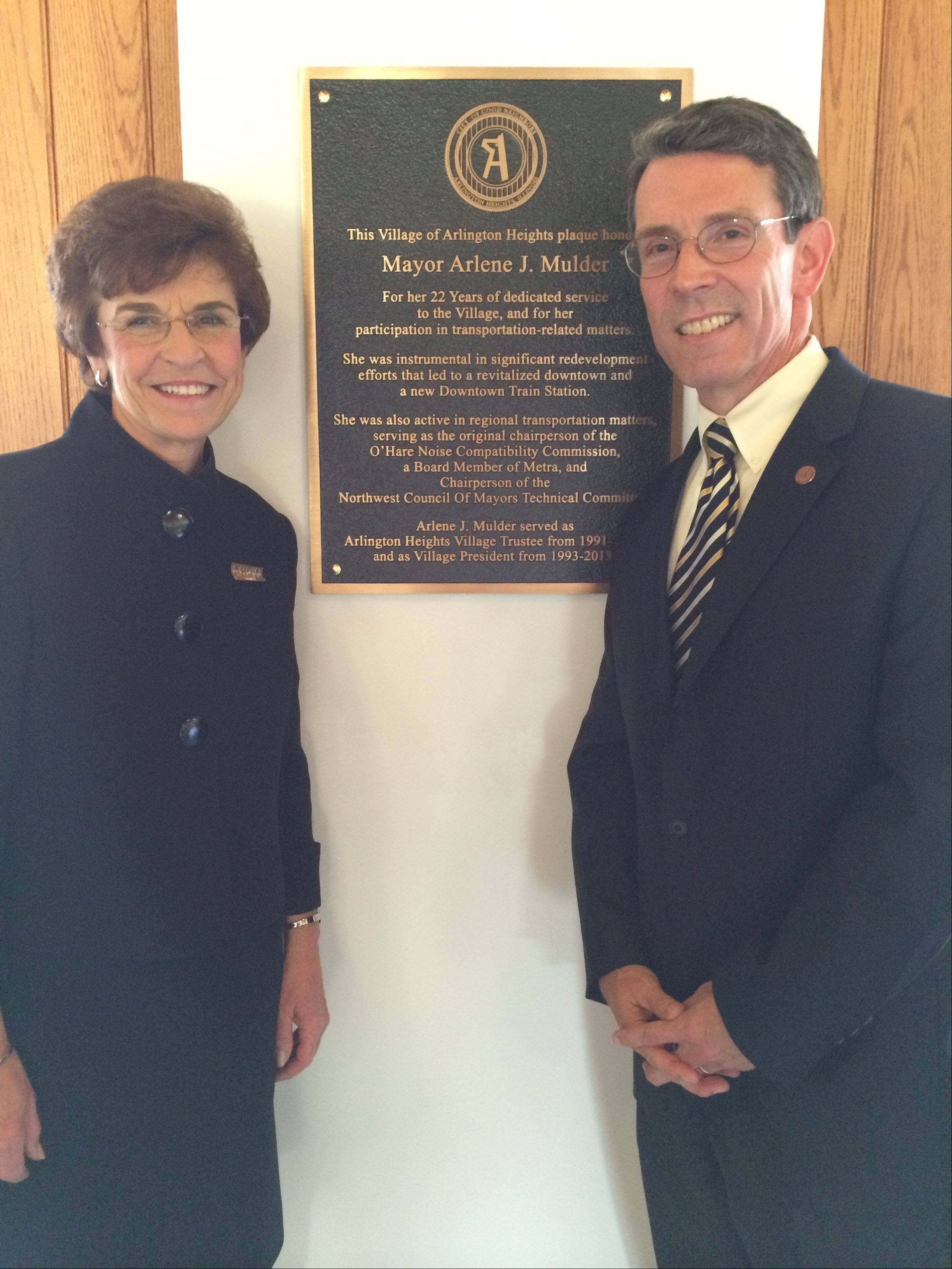 Former Arlington Heights Mayor Arlene Mulder and current Mayor Tom Hayes unveil a plaque at the downtown train station on Tuesday honoring Mulder's 22 years of service to the village and her work on regional transportation issues.