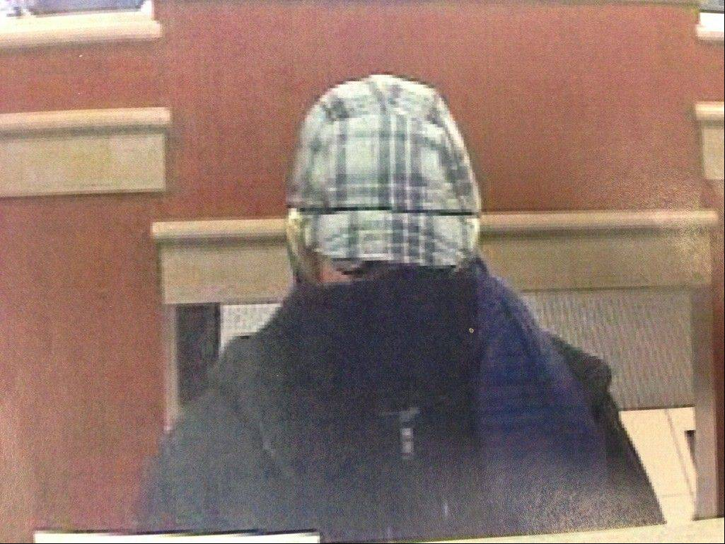 Authorities say this surveillance image shows the man who robbed a Fifth Third Bank branch Tuesday afternoon in Oak Brook.