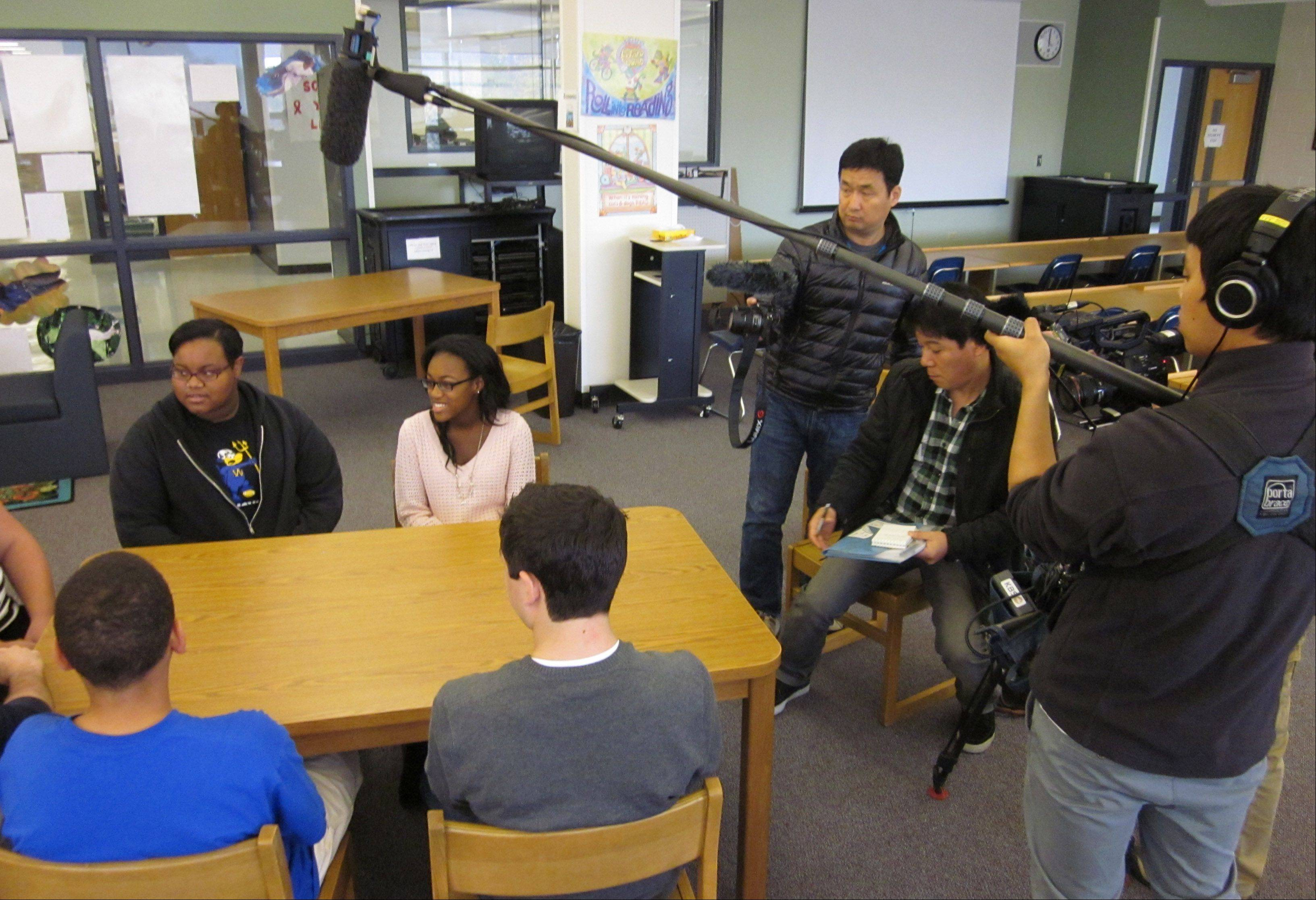 Five freshmen at Warren Township High School's O'Plaine Road campus in Gurnee on Tuesday discuss an innovative teaching method known as a flipped classroom for Korean Broadcasting System's education documentary.