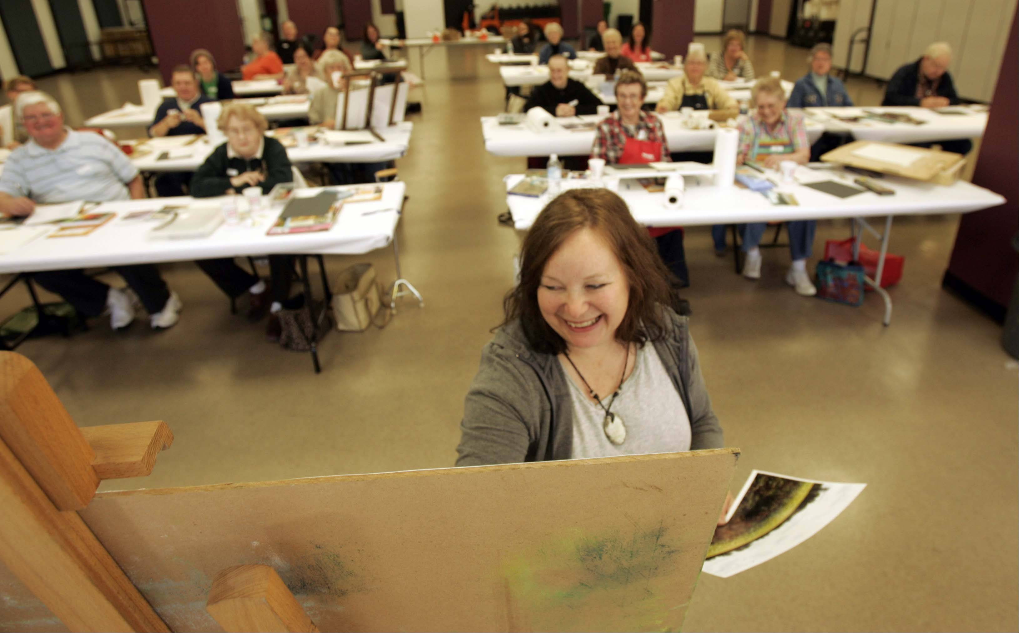 Michigan-based artist Susan Henshaw, shown here in 2011, returns to Elgin Saturday to teach a pastel techniques workshop part of the Elgin FallBack Arts Festival. This is the third edition of the festival.
