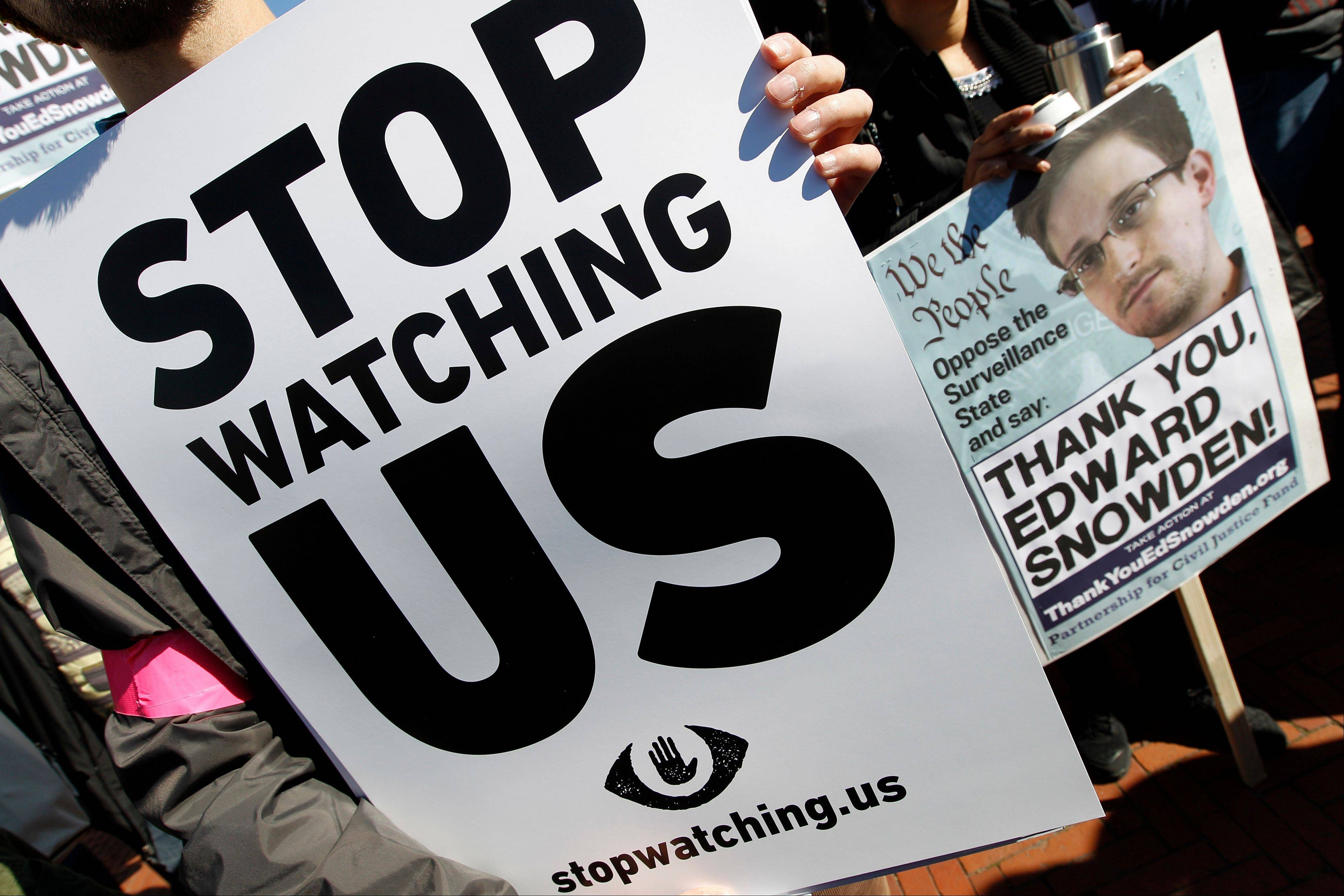 Demonstrators protest outside of the U.S. Capitol in Washington during a rally to demand that the U.S. Congress investigate the National Security Agency's mass surveillance programs Saturday, Oct. 26, 2013.