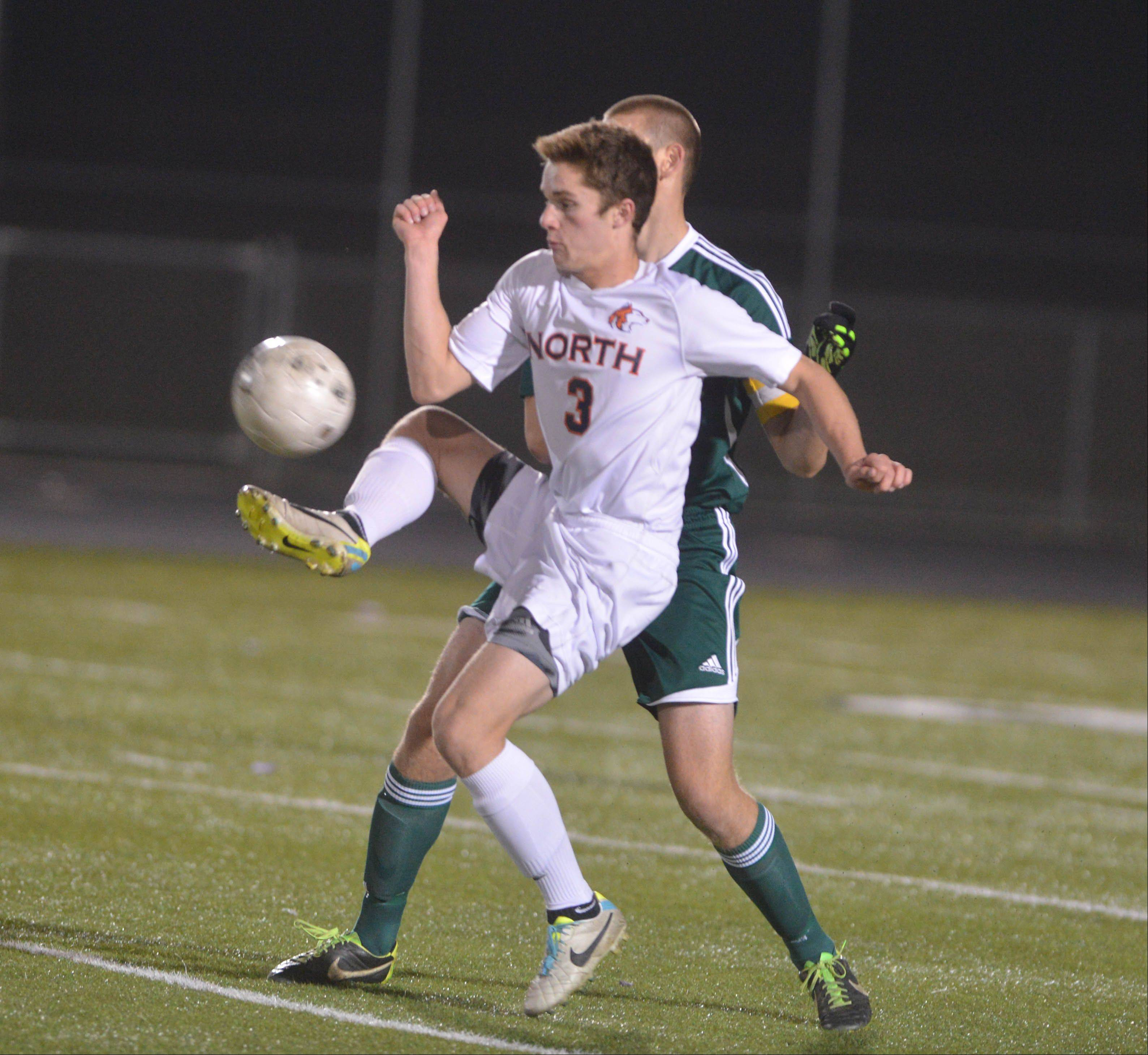 Chris Ensign of Naperville North moves the ball during the Naperville North vs. Waubonsie Valley boys soccer Class 3A Metea Valley sectional semifinals Tuesday.