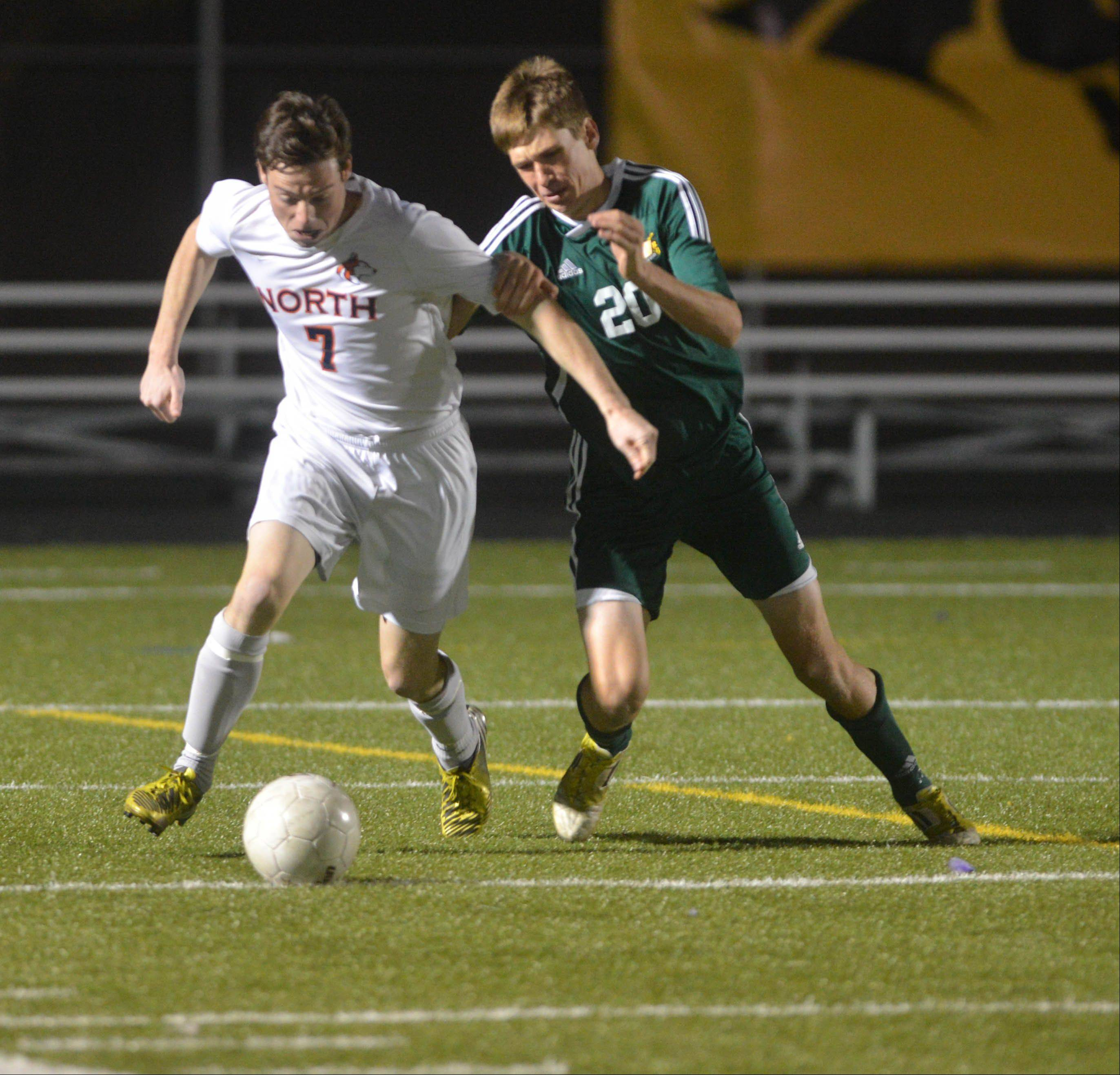 Alec Thompson of Naperville North and Drew Valek of Waubonsie vie for the ball during the Naperville North vs. Waubonsie Valley boys soccer Class 3A Metea Valley sectional semifinals Tuesday.