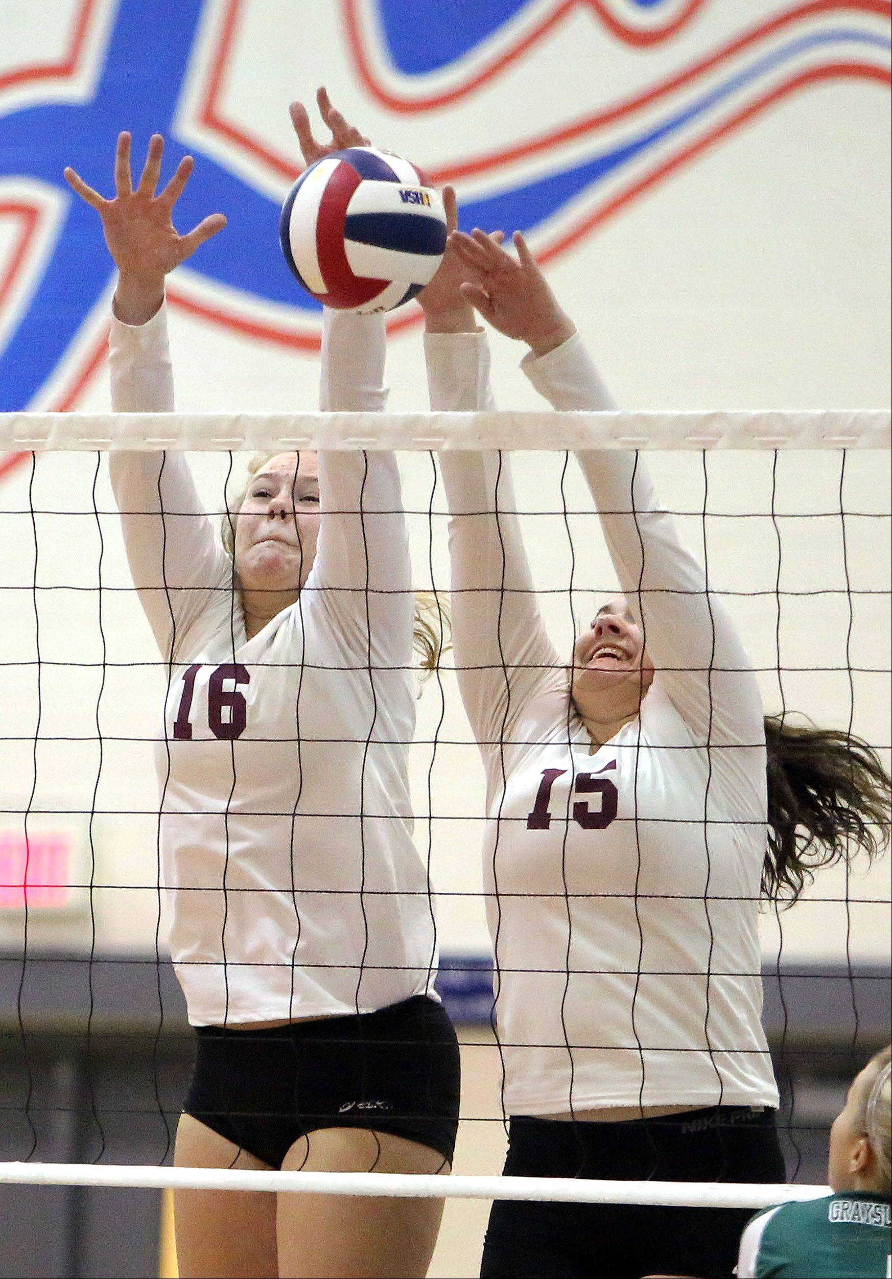 Antioch's Samantha Falco, left, and Brenna Lamusga go up for a block during their regional semifinal against Grayslake Central on Tuesday at Lakes.