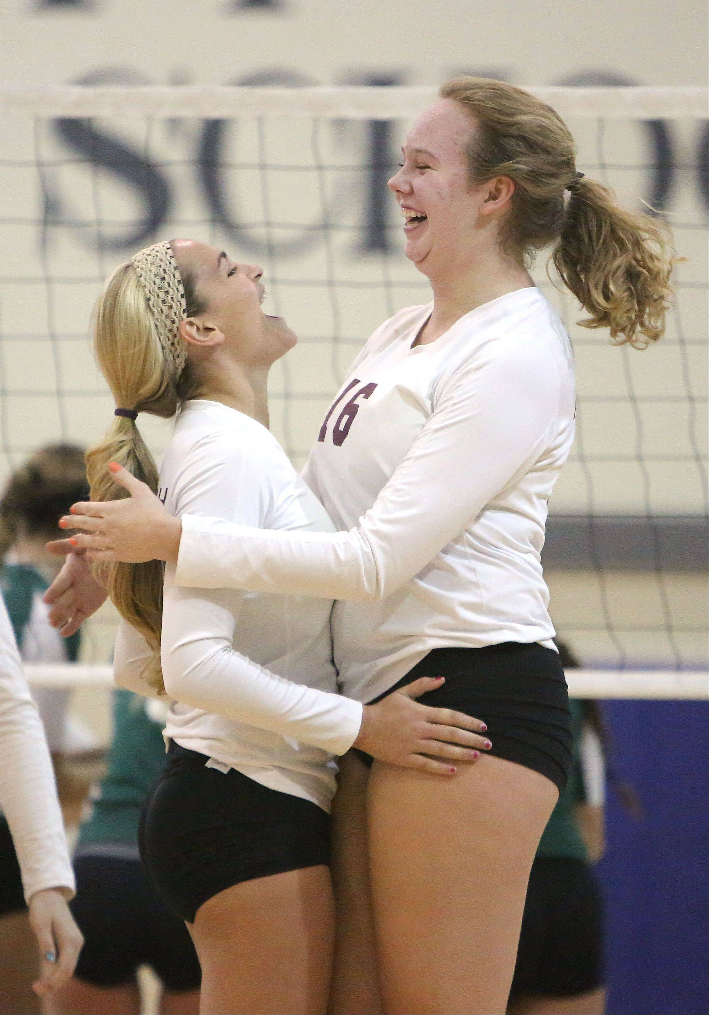 Marissa Grant, left, Samantha Falco celebrate after a point during their regional semifinal against Grayslake Central Tuesday at Lakes.