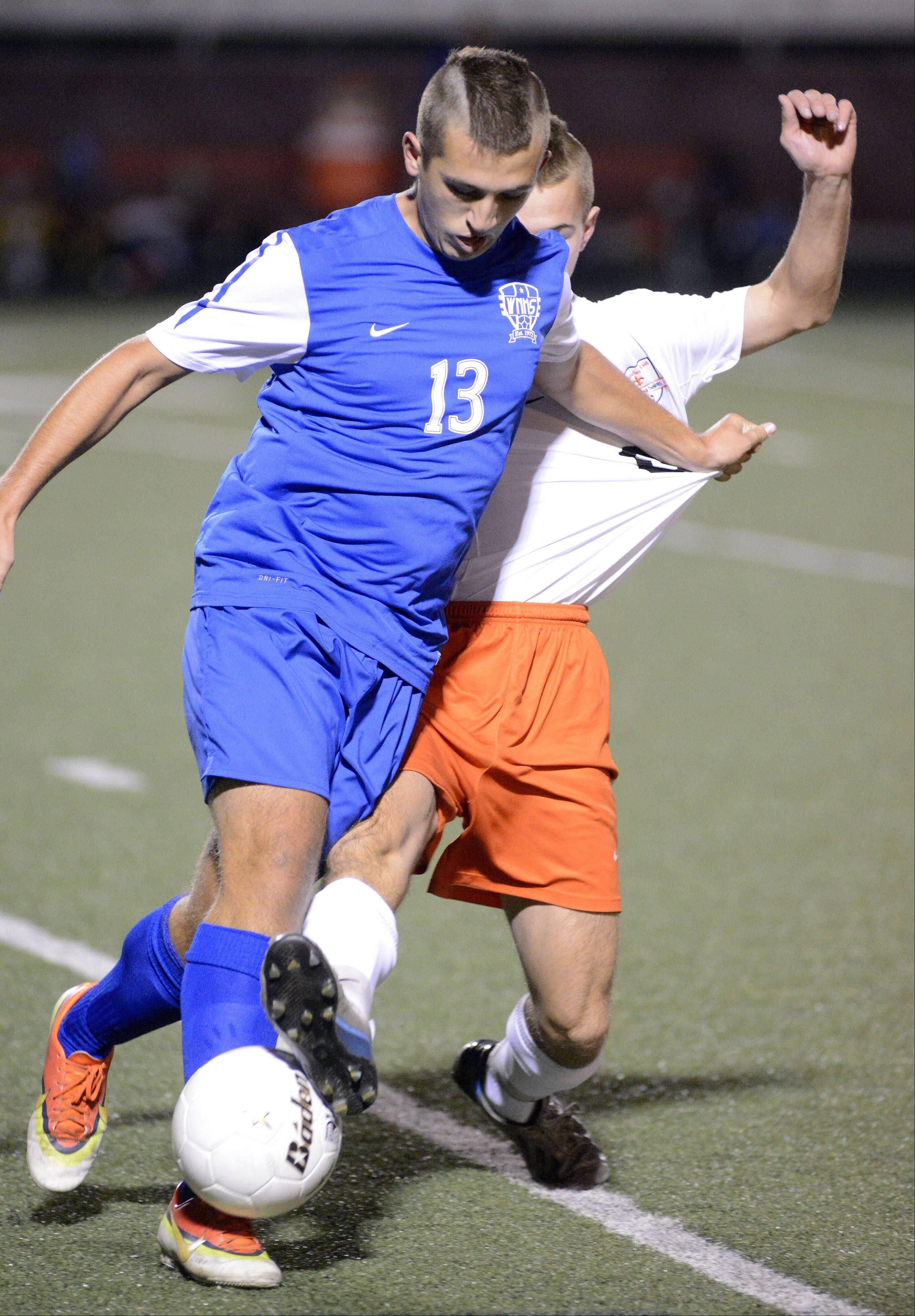 Wheaton North's Zoran Tanasic battles St. Charles East's Kyle McLean for the ball in the first half of the Schaumburg sectional semifinals on Tuesday, October 29.