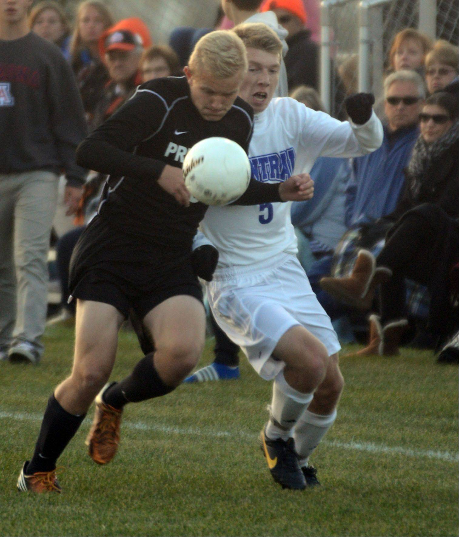 Burlington Central's Chris Leberecht, right, battles Freeport's Andrew Woods during a soccer sectional semifinal game at Burlington on Tuesday night.