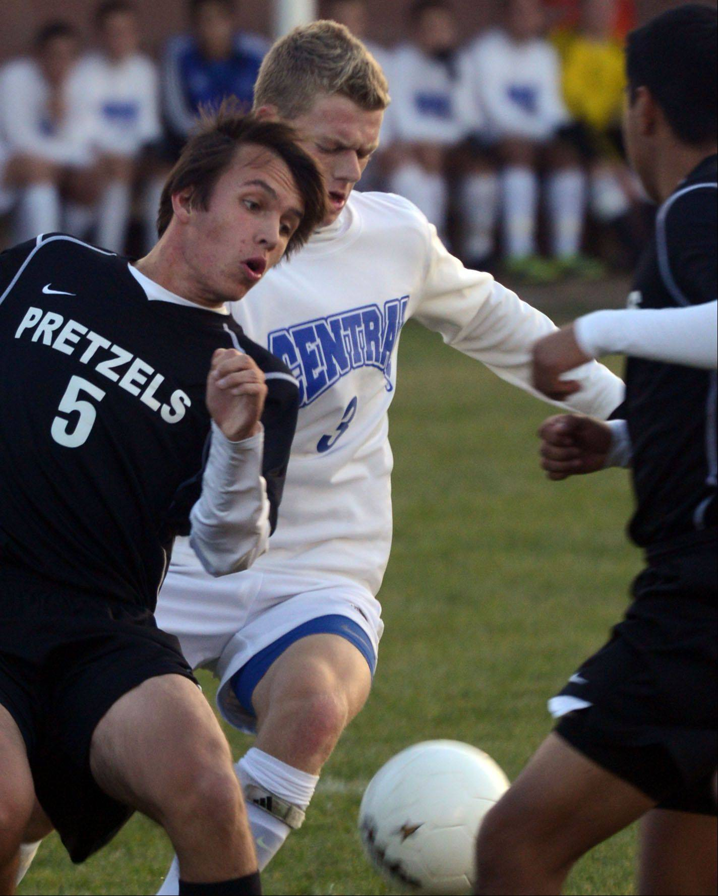Burlington Central's Stefan Jochum, right, battles Freeport's Philip Ohrtmann, left, during a soccer sectional semifinal game at Burlington on Tuesday night.