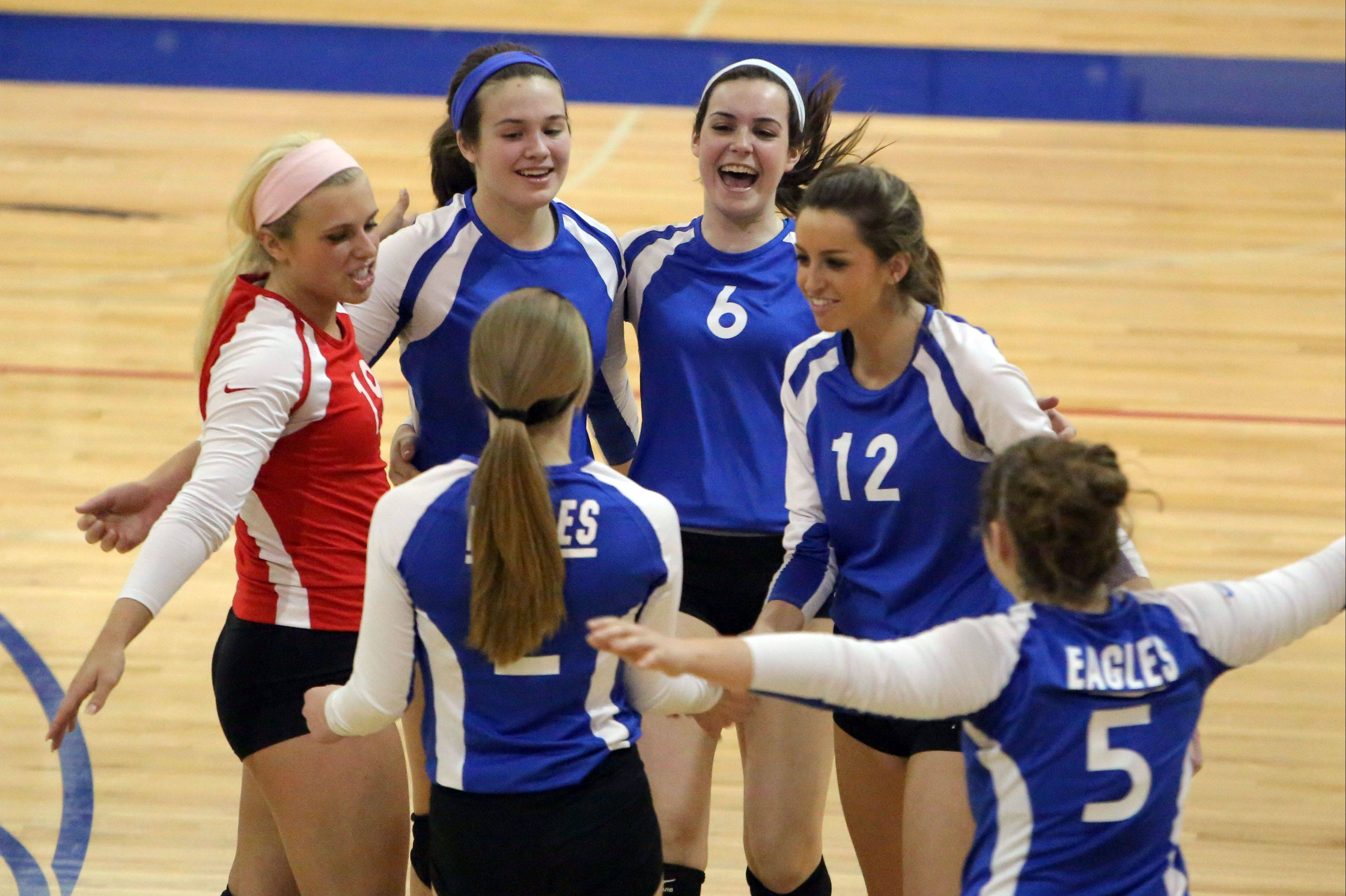 The Lakes team celebrate after beating Wauconda during the girls volleyball regional semifinal game Tuesday at Lakes.