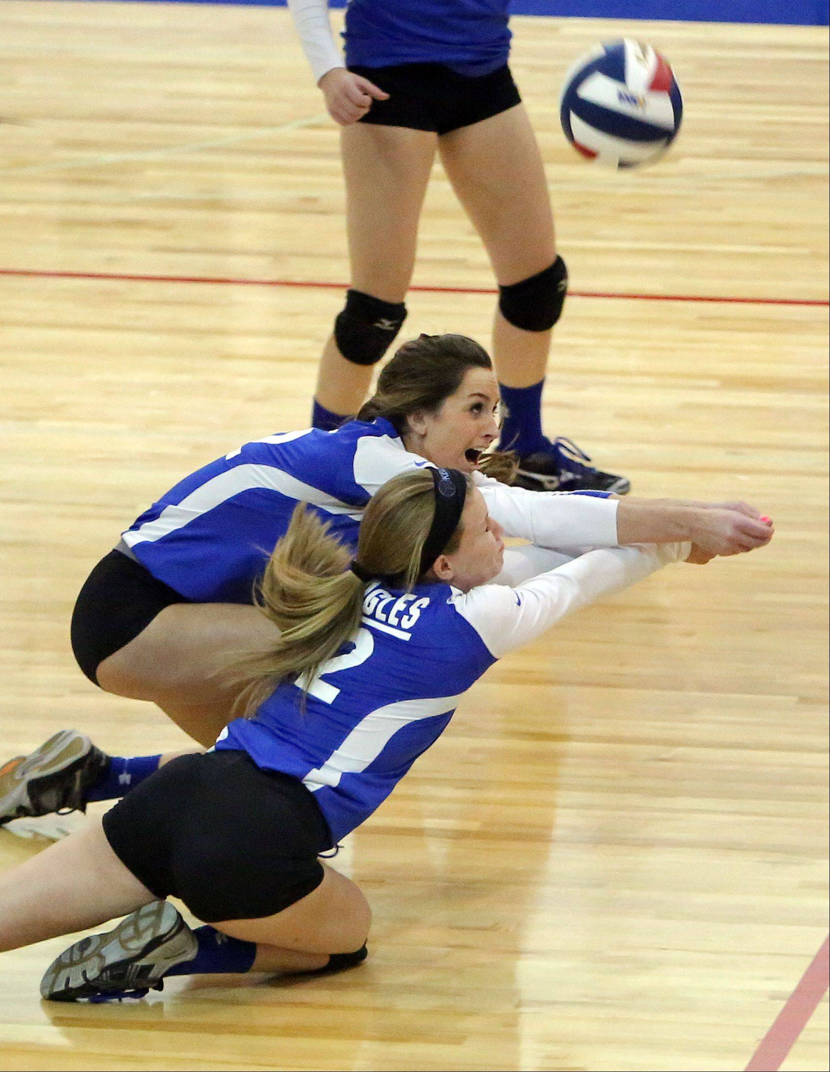 Lakes' Haley Halberg, left, and Lisa Buehler go for a loose ball during the girls volleyball regional semifinal game Tuesday at Lakes.