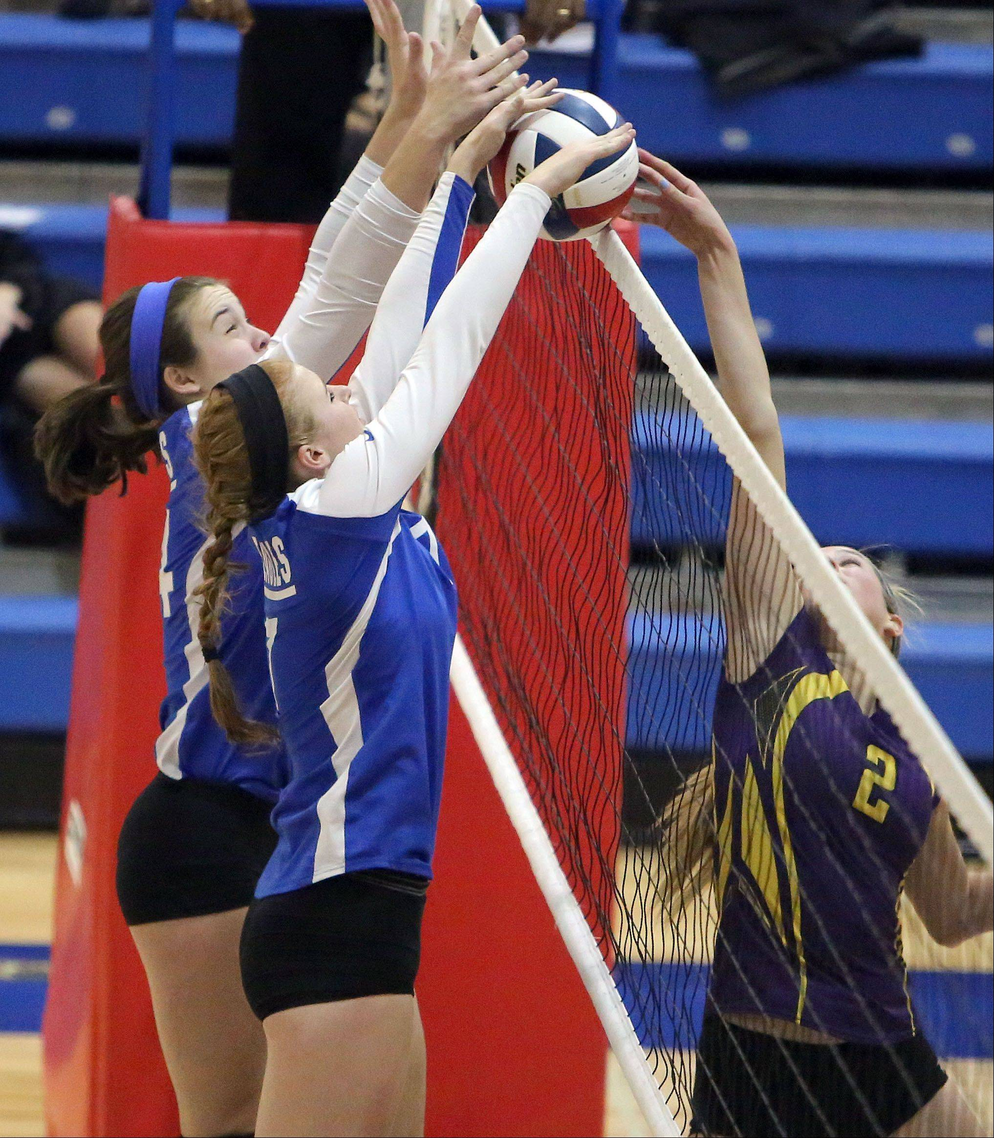 Lakes' Megan Behrendt, left, and Allie Grandos go up to block the shot of Wauconda's Susan Karhoff during the girls volleyball regional semifinal game Tuesday at Lakes.