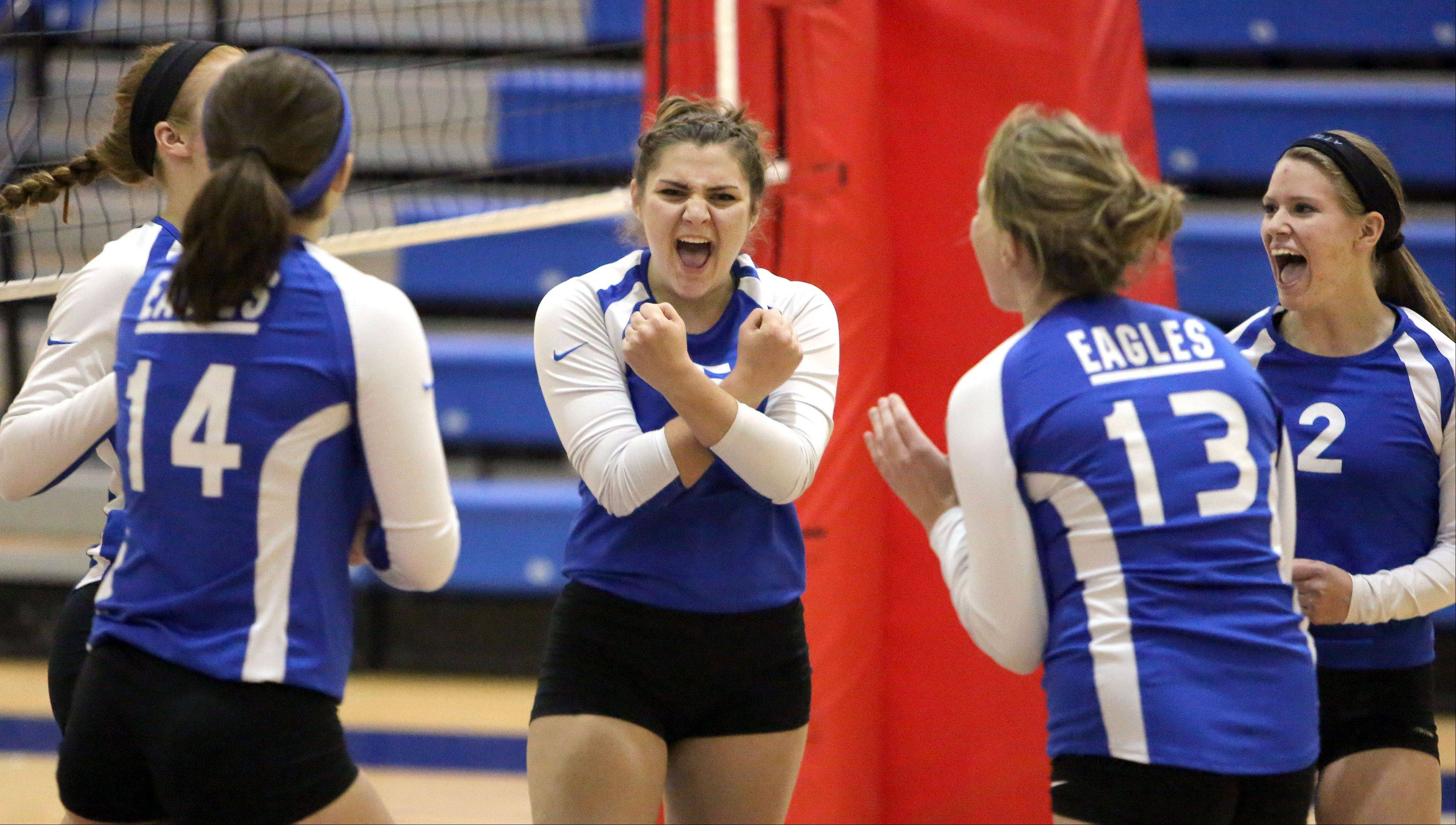 Lakes' Maddie Demo celebrates with teammates after winning a point against Wauconda during the girls volleyball regional semifinal game Tuesday at Lakes.
