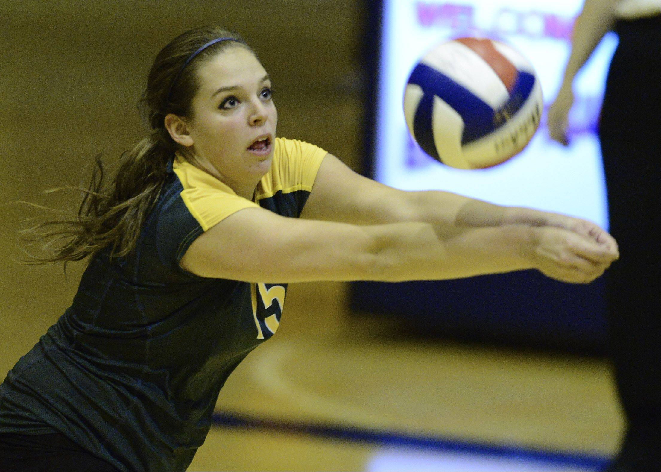 Stevenson's Alexa Bykowski hustles for a dig during Tuesday's regional semifinal against Conant at Buffalo Grove.