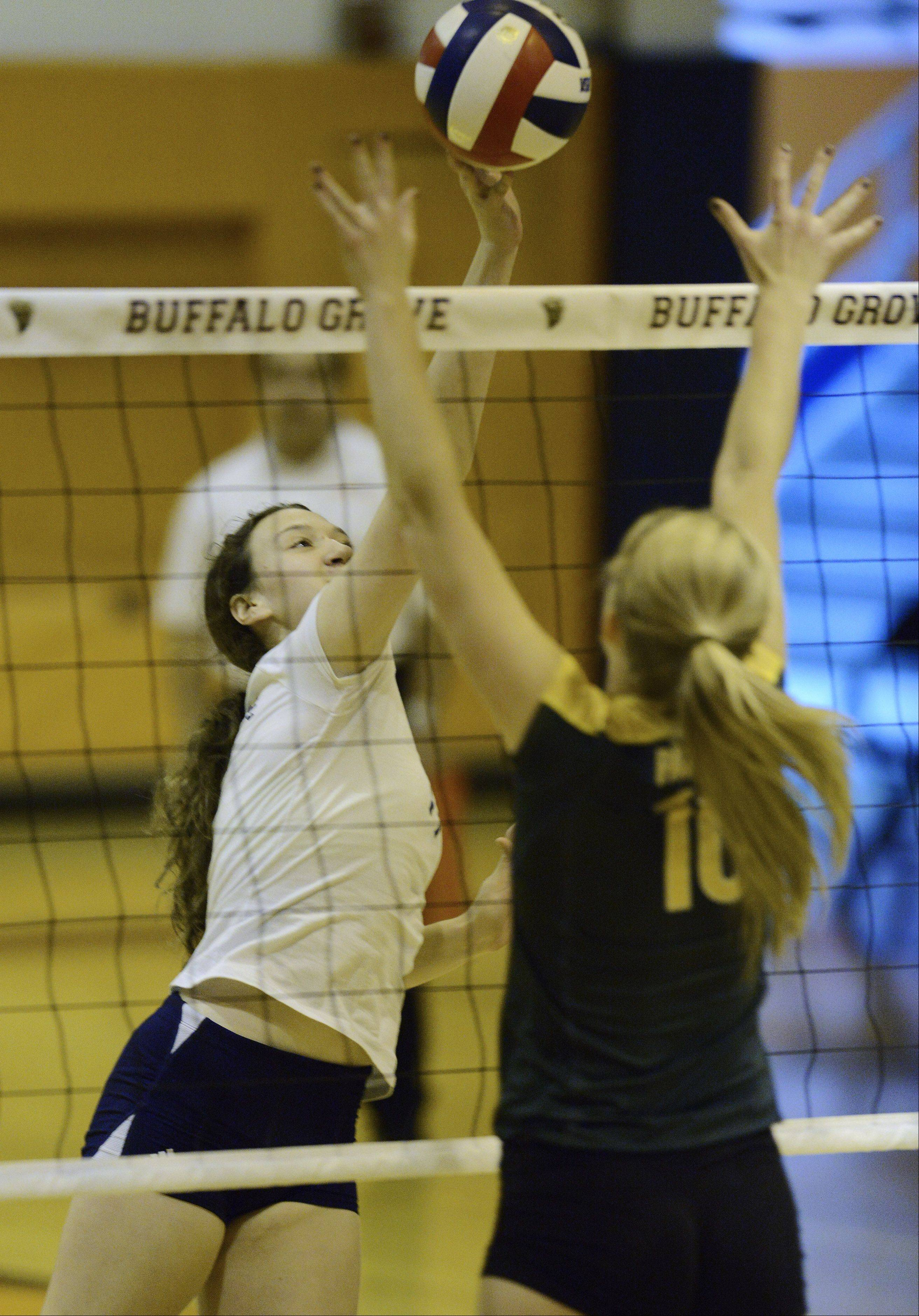 Conant's Daniele Sortino taps the ball over the net in front of Stevenson's Jennifer Kapov during Tuesday's regional semifinal at Buffalo Grove.