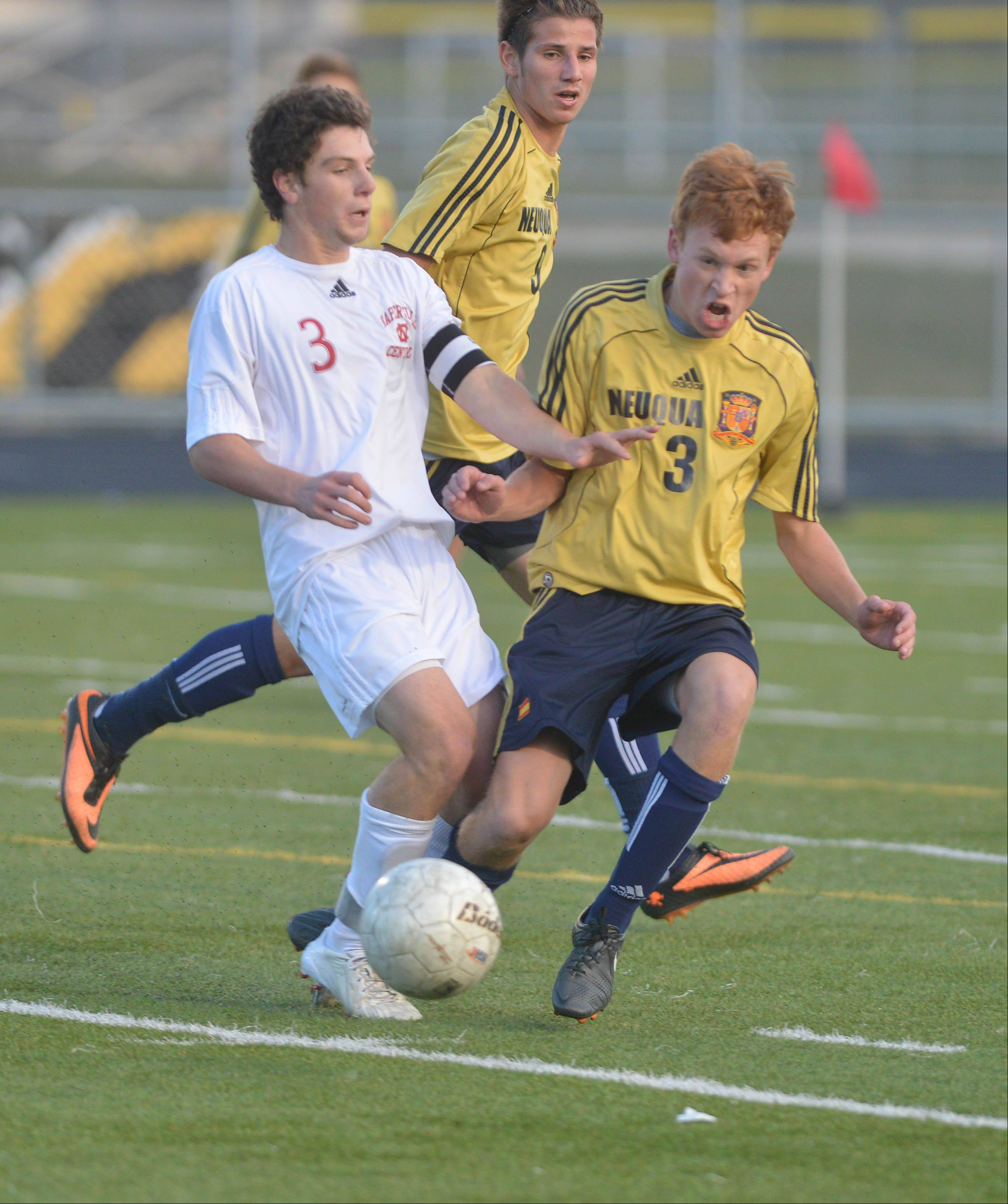Jay Tegge of Naperville Central and Reed Kurtenbach of Neuqua Valley go after a loose ball during the Naperville Central vs. Neuqua Valley boys soccer Class 3A Metea Valley sectional semifinals game Tuesday.