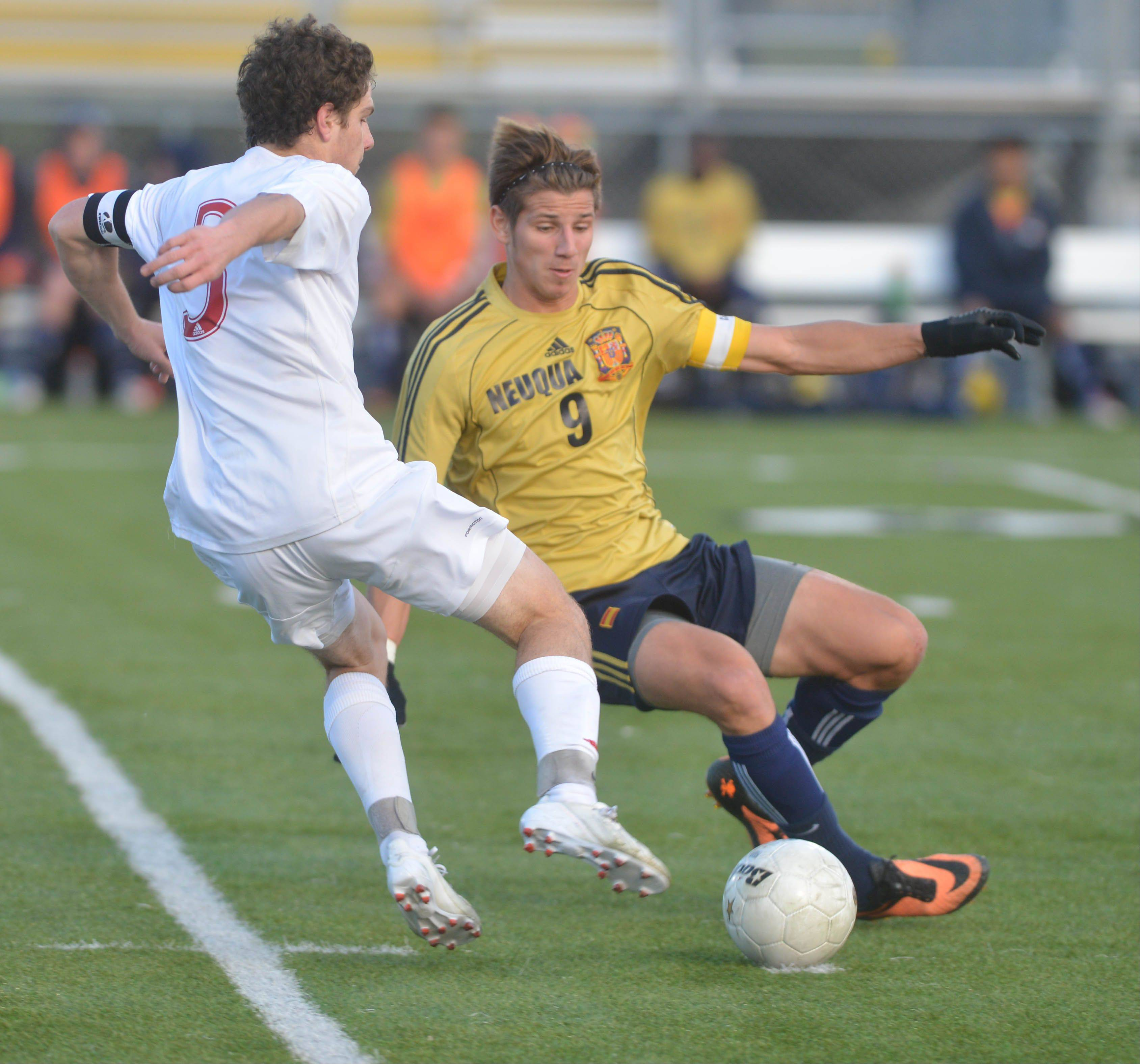 Jay Tegge of Naperville Central and Jake Loncar of Neuqua Valley go after a loose ball during the Naperville Central vs. Neuqua Valley boys soccer Class 3A Metea Valley sectional semifinals game Tuesday.