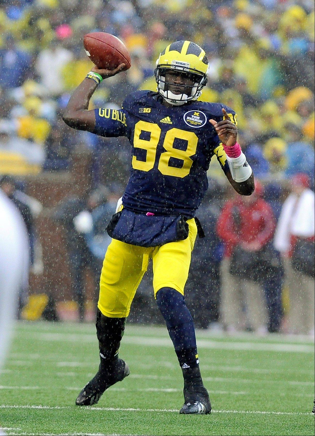 Michigan quarterback Devin Gardner throws a pass in the rain during the Oct. 19 game against Indiana in Ann Arbor, Mich.