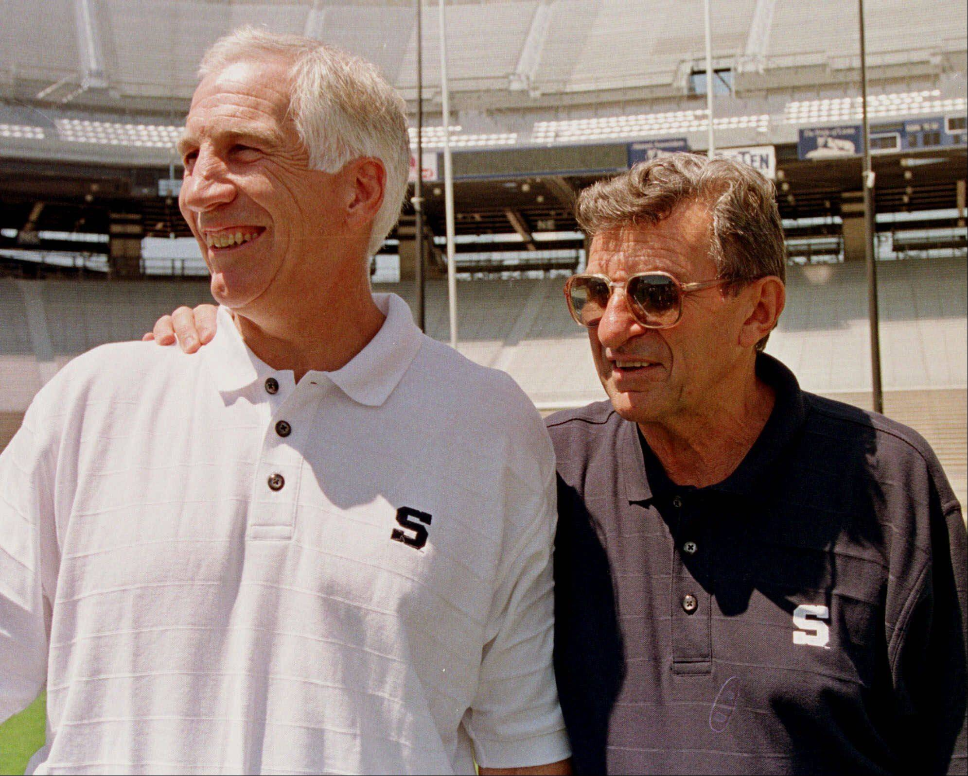 Penn State head football coach Joe Paterno, right, poses with his defensive coordinator Jerry Sandusky. A lawsuit by Joe Paterno's family and others against the NCAA is scheduled to go to court Wednesday, Oct. 30, 2013, one day after Penn State announced settlements with 26 young men over claims of abuse by Jerry Sandusky.