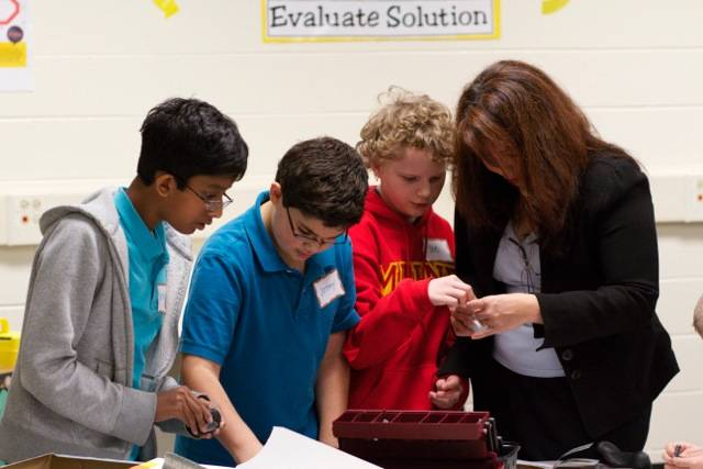 Addams Junior High School students show U.S. Rep. Tammy Duckworth projects they are working on as part of the school's STEM (science, technology, engineering and math) programming. Duckworth visited the Schaumburg school on Friday, Oct. 25.