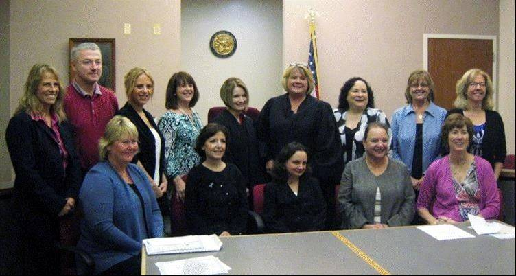 Lake County CASA's 12 new court appointed special advocates and their two Lake County juvenile court judges, front row: Nina Sorensen, Cecilia Milotti, Viola Stamm, Shelley Spathis, and CASA trainer Debra Lerner-Schmidt; back row: Kristin Leonard, Brian Jakob, Alya Smolsky, Julia Foster, Judge Sarah Lessman, Judge Valerie Ceckowski, Marla Hindin, Jane Lindstrom and Lee Galarce.