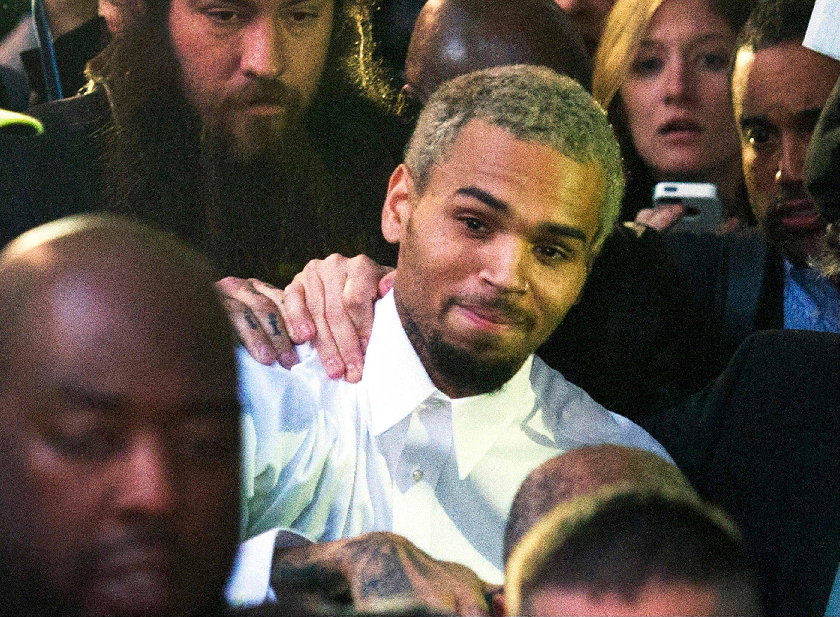 A representative for the R&B singer Chris Brown announced Tuesday that Brown has decided to go to rehab to �gain focus and insight into his past and recent behavior, enabling him to continue the pursuit of his life and his career from a healthier vantage point.�
