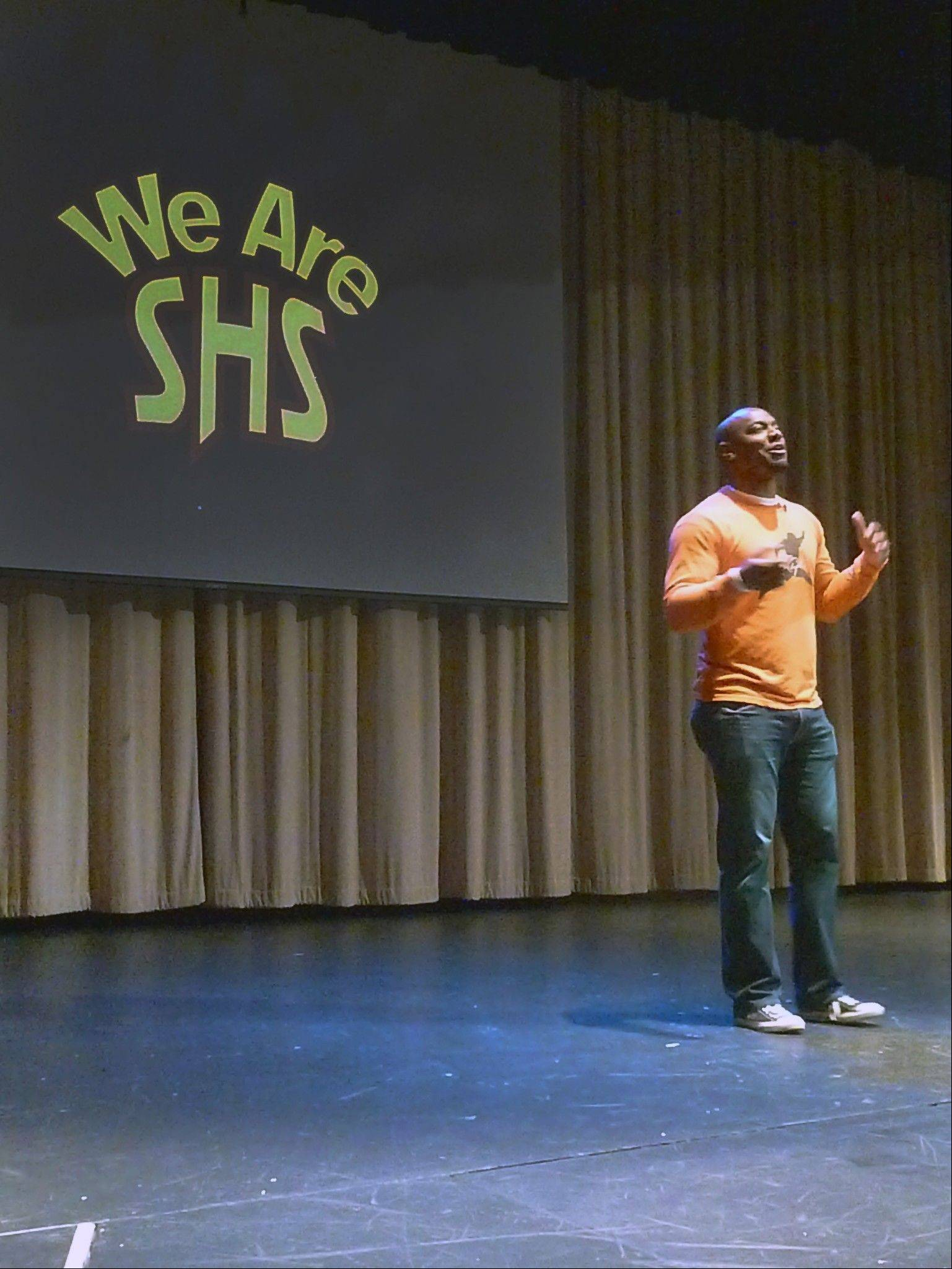 Jarrett Payton speaks to students at Schaumburg High School about bullying on Wednesday. Payton, whose foundation supports anti-bullying efforts, appeared as part of the school�s �SHS Unites Day.�