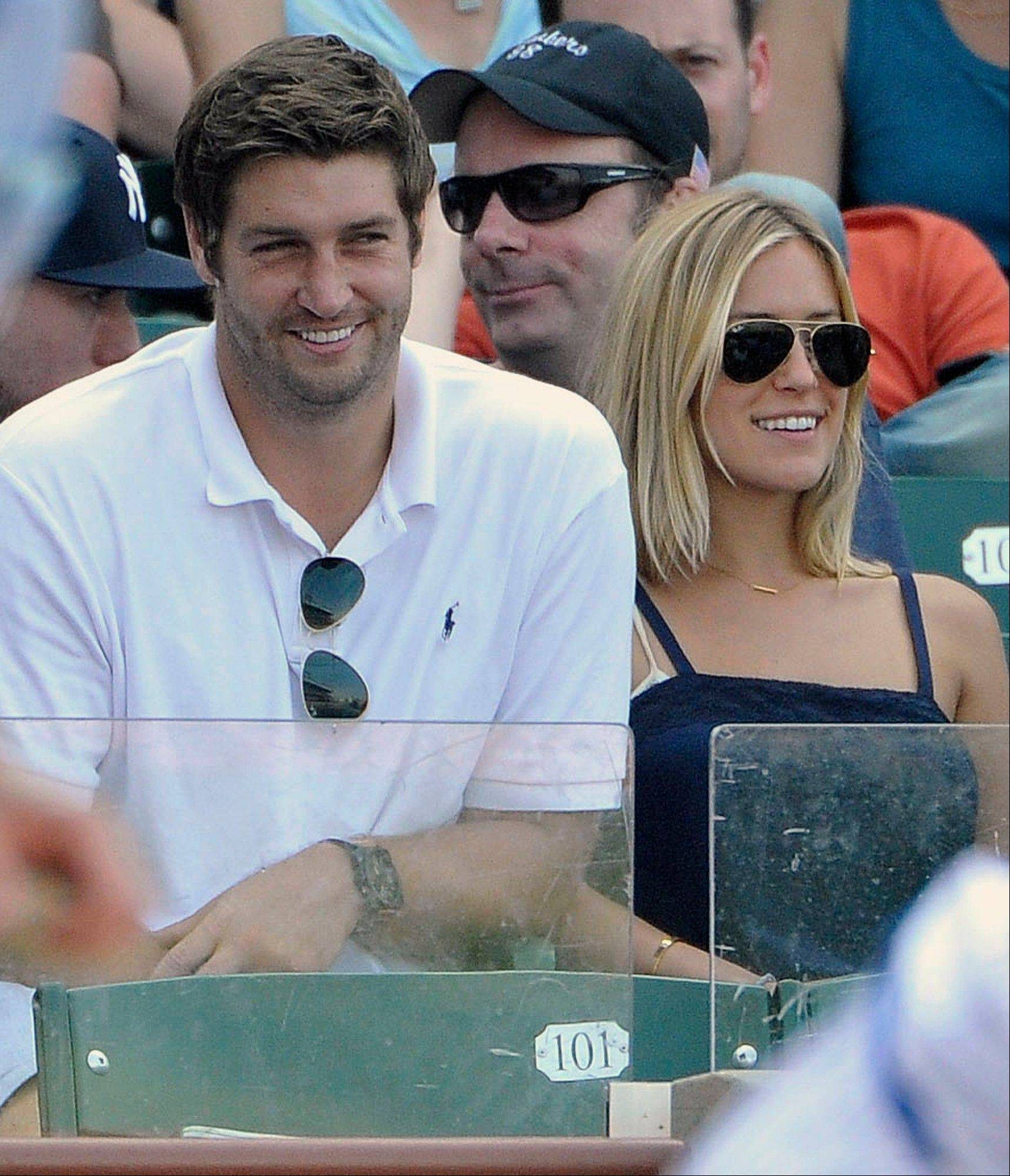 FILE - In this July 2, 2011, file photo, Chicago Bears quarterback Jay Cutler, center, and Kristin Cavallari watch the Chicago Cubs play the Chicago White Sox during an interleague baseball game in Chicago. Cutler and Cavallari are engaged again. The reality TV star announced the engagement Wednesday, Nov. 30, 2011, on her Twitter feed, saying: �This time its official..Jay and I are engaged again :).� (AP Photo/Brian Kersey, File)