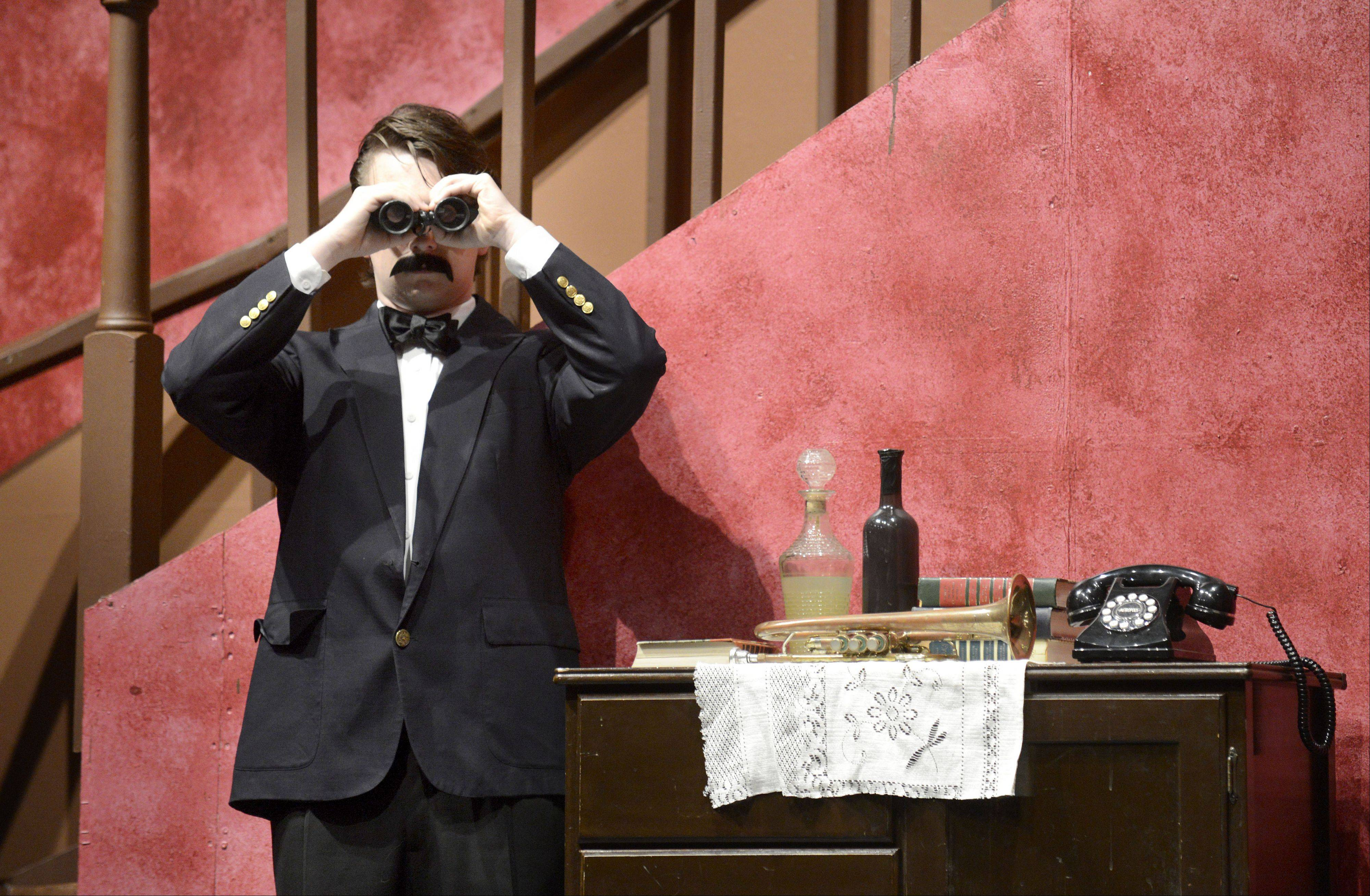 Michael Kelley portrays Teddy Brewster, who thinks he�s Teddy Roosevelt, in Elgin High School�s production of �Arsenic and Old Lace.�