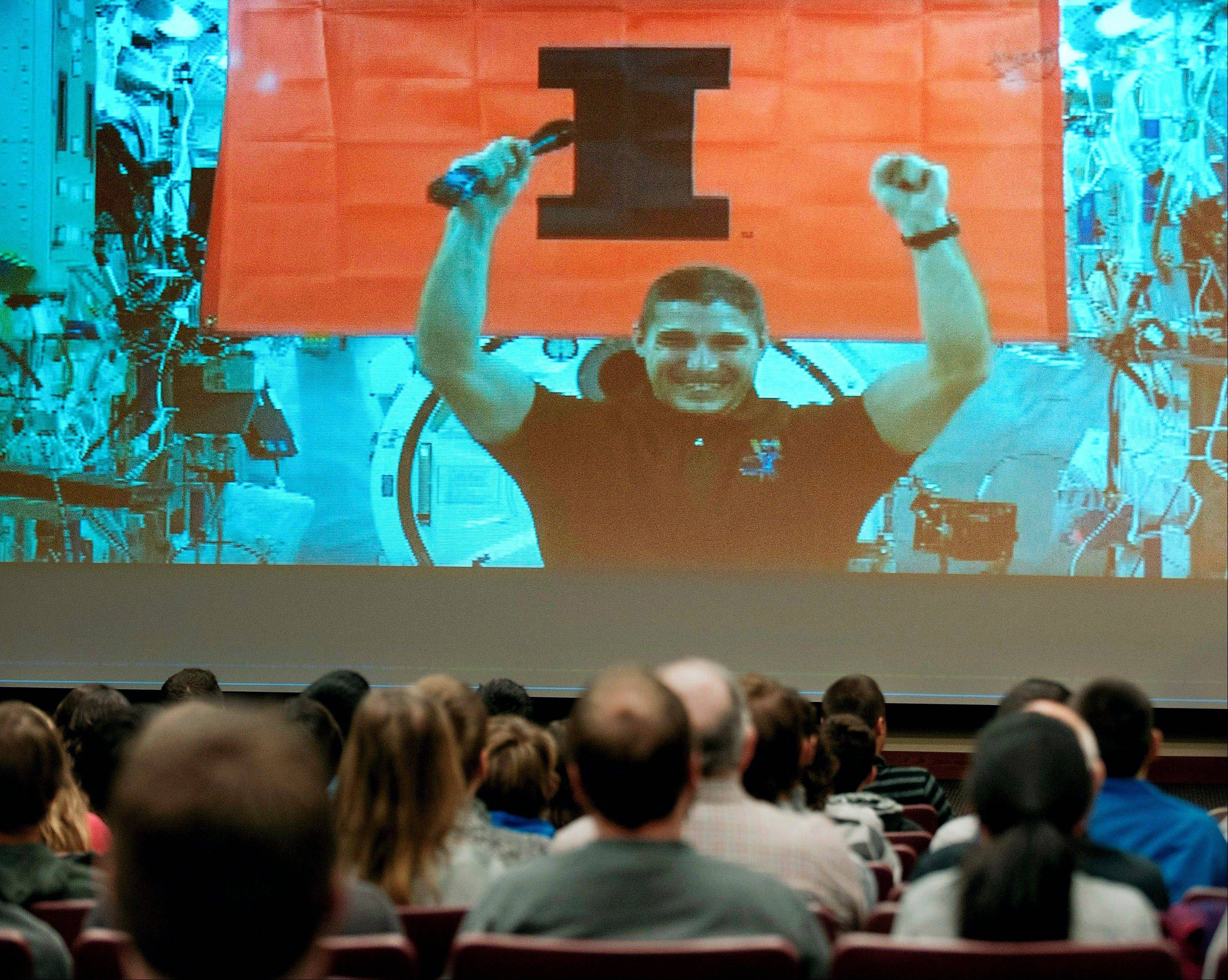 Mike Hopkins, a 1991 engineering graduate of the University of Illinois, greets an audience at his alma mater in Urbana through a live video chat from the International Space Station. Hopkins had 10 minutes to answer questions from Illini aerospace engineering students at the University of Illinois National Center for Supercomputing Applications.