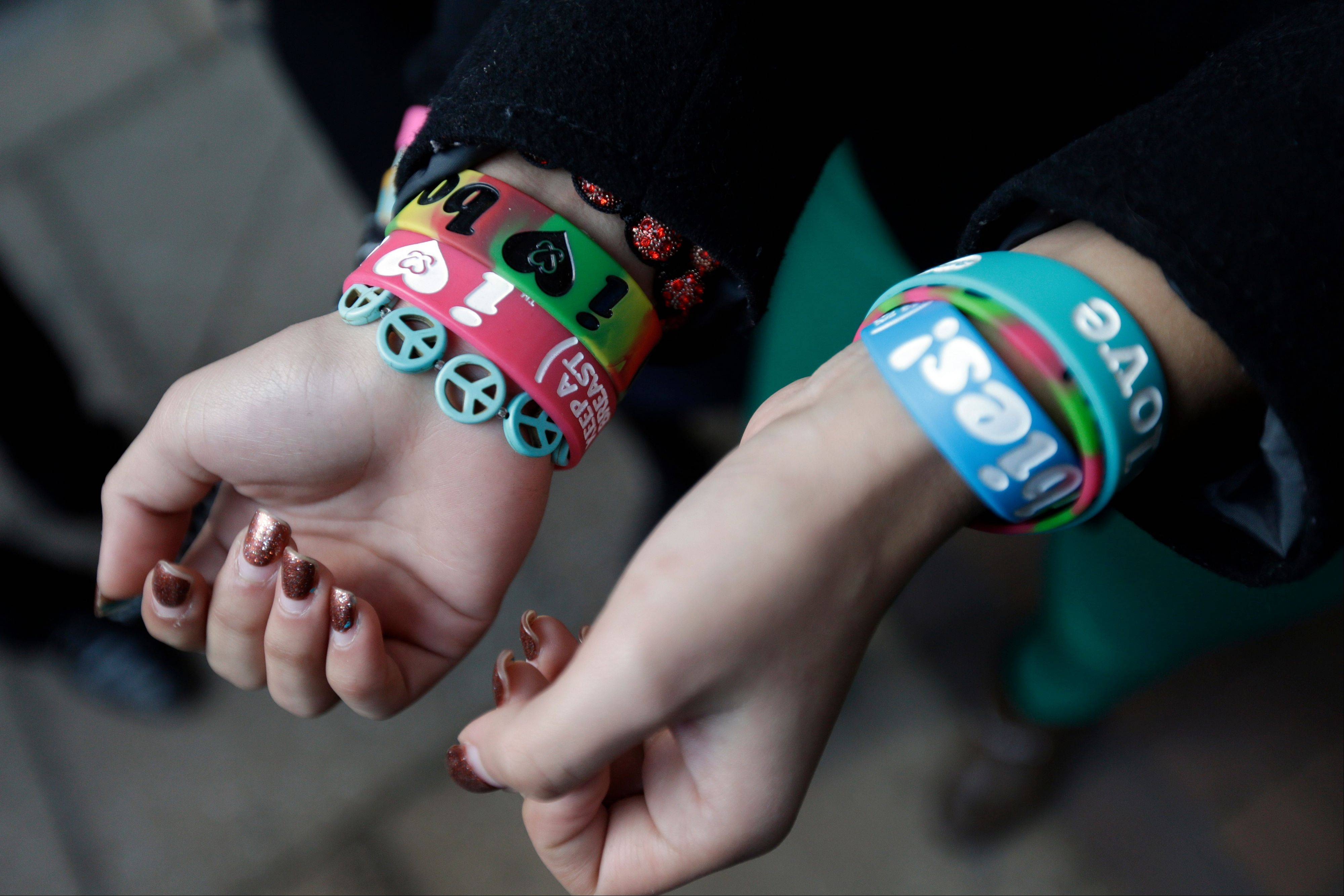 Easton Area School District students Brianna Hawk, left, and Kayla Martinez, display their �I (heart) Boobies!� bracelets for photographers outside the U.S. Courthouse in Philadelphia. The Easton Area School District says it will take its fight against �I (heart) Boobies!� bracelets to the U.S. Supreme Court. The board voted 7-1 Tuesday night, Oct. 29, 2013 to appeal a decision rejecting its claim the bracelets are lewd and should be banned from school. The bracelets are designed to promote breast cancer awareness among young people.