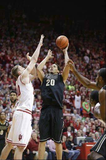 Purdue center A.J. Hammons shoots over Indiana forward Cody Zeller in the first half of a game last season in Bloomington, Ind.