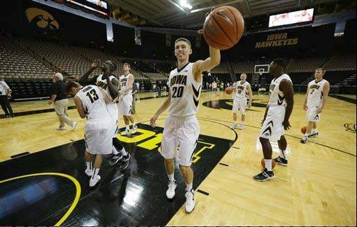 Iowa forward Jarrod Uthoff grabs a rebound while shooting with teammates during the school�s annual basketball media day Oct. 9 in Iowa City.