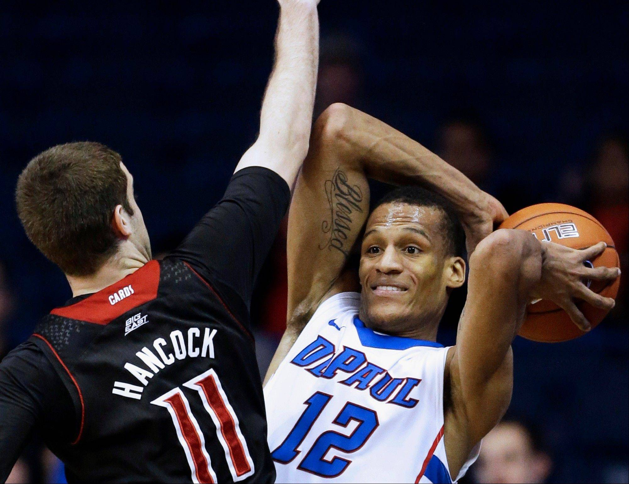 DePaul�s Cleveland Melvin, right, looks to pass against Louisville�s Luke Hancock during a game last season in Rosemont.