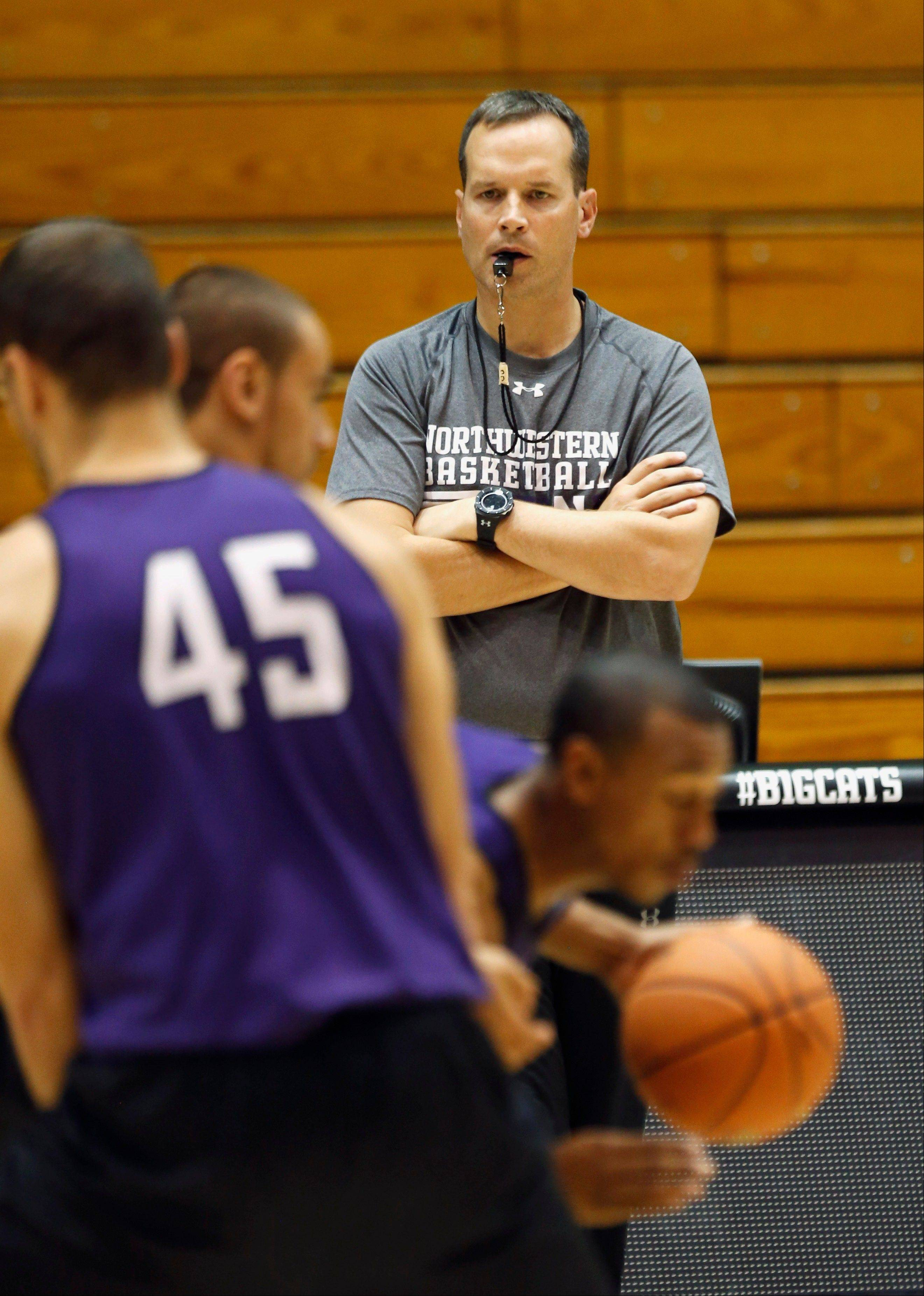 New men�s basketball coach Chris Collins watches over Northwestern�s practice Monday in Evanston.